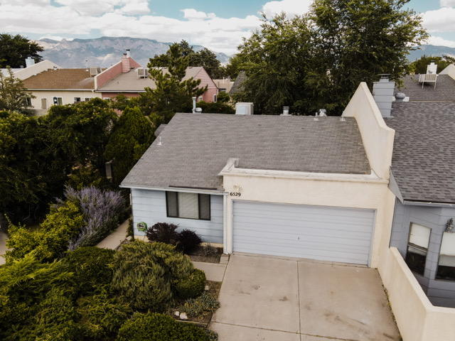 Beautifully remodeled town home in the heart of Albuquerque conveniently located to restaurants,  shopping,  and easy access to I25. This fabulous home boasts granite countertops, laminate wood floors, two bedrooms, 2 baths with updated tile.  Schedule your showing before it's gone!