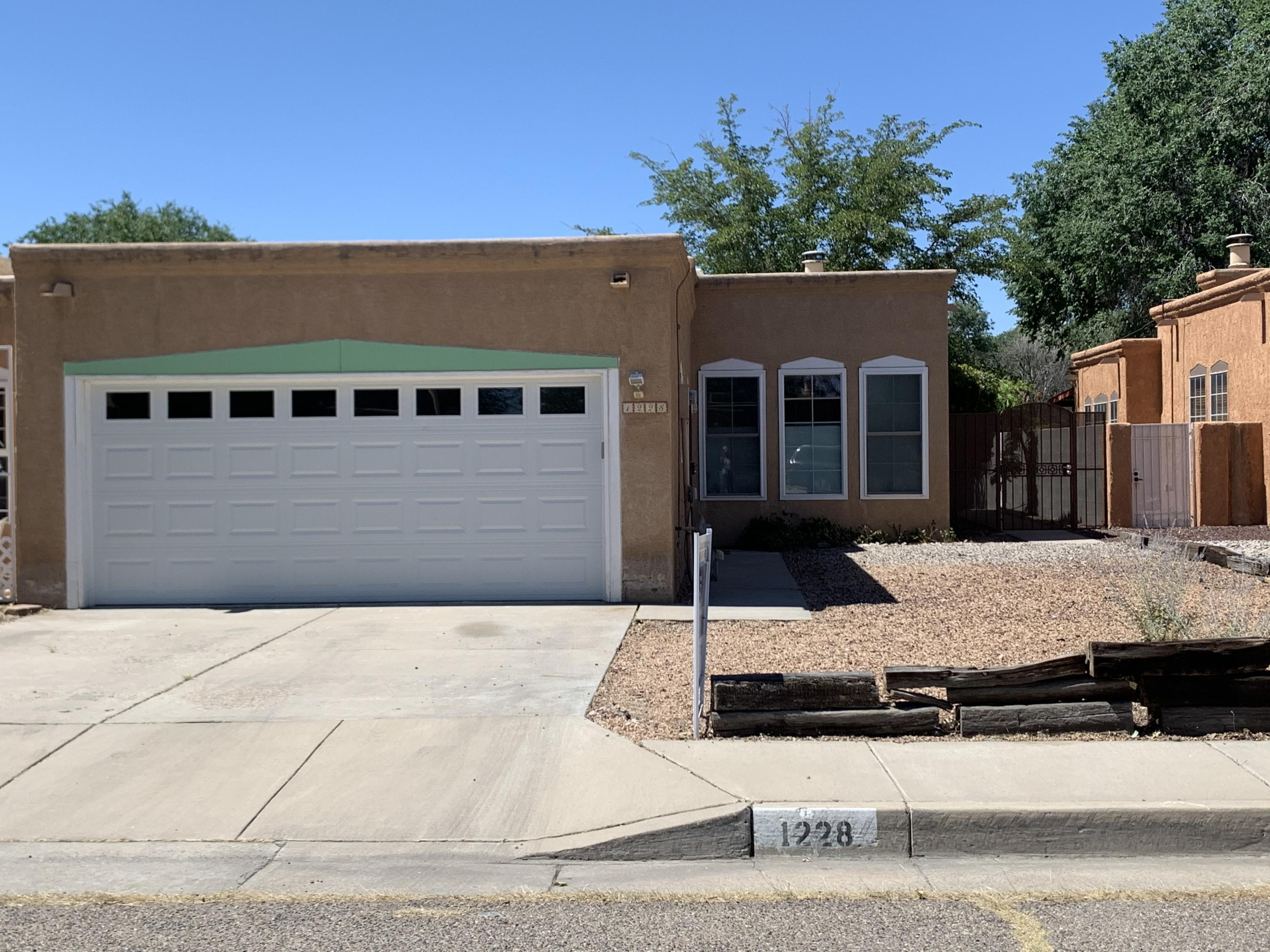 Move in ready North Valley town home with contemporary updates.  Laminate flooring throughout  (no carpet), honeycomb blinds, new dishwasher and fridge, stainless steel sink and granite countertops.  No HOA and conveniently located to I-40.