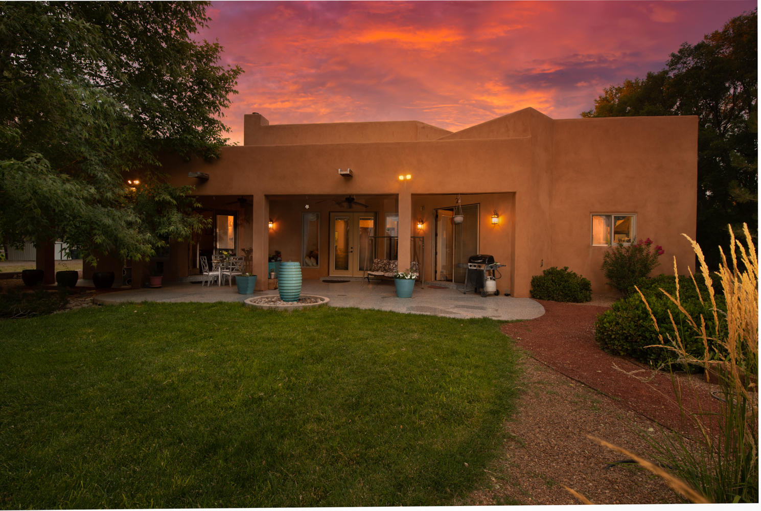Oasis in the desert!  This remarkable home on 3.4 acres is paradise for you and your animals.  With MGRCD irrigation rights, and pole fencing all around, this property is ready for all to move-in.Enter through a cozy, fireplaced courtyard to a home where architectural details abound.  The exquisite LR  has cathedral ceilings with tongue-in-groove detailing, a soaring fireplace and large custom windows. The Wolf appliances, in this Chef's kitchen, include Sub Zero Refrigerator, Convection Oven, Cook Top, Warming Drawer and a pot filler!  The Master Bath has a corner jetted tub as well as a magnificent rain shower.  The Master Bedroom boasts another custom Fireplace with entrance to a patio with a water feature overlooking the land.Come experience  beauty and tranquility of your new