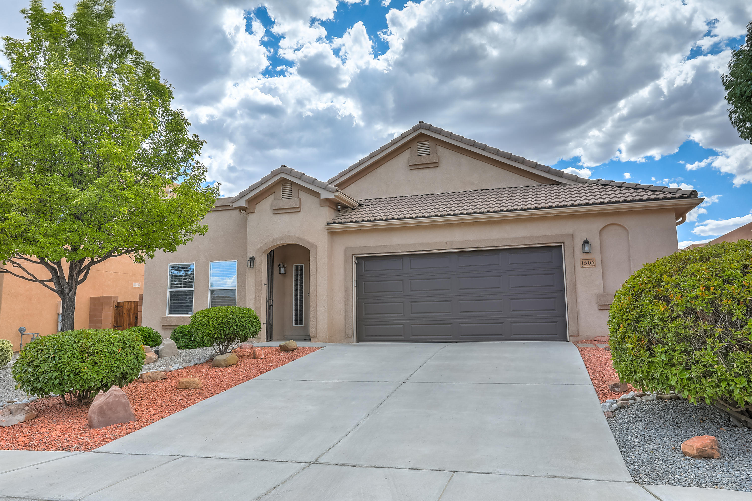 Hurry to see this 1 story stunner in desirable Cabezon Subd. in S. Rio Rancho. The home has it all!  Open floor plan w/ kitchen, dining and great room all one contiguous space. Kitchen has new dishwasher & micro.  2 pantries & lots of counter space. Raised beamed ceiling in great room w/ cozy fireplace. Split floor plan w/ spacious owners suite w/ luxe ensuite bath w/ garden tub and separate shower. Two generously sized guest rooms w/ shared bathroom. 4th possible bedroom is also the perfect office or play space. Backyard is an oasis w/ small gunite pool w/ new heater, cabana & putting green. Paid solar means virtually no electric bill!  Garage is oversized (2.5 spaces) w/ professionally installed epoxy coated floor & modified ceiling to accommodate a car lift - high speed door lift too!
