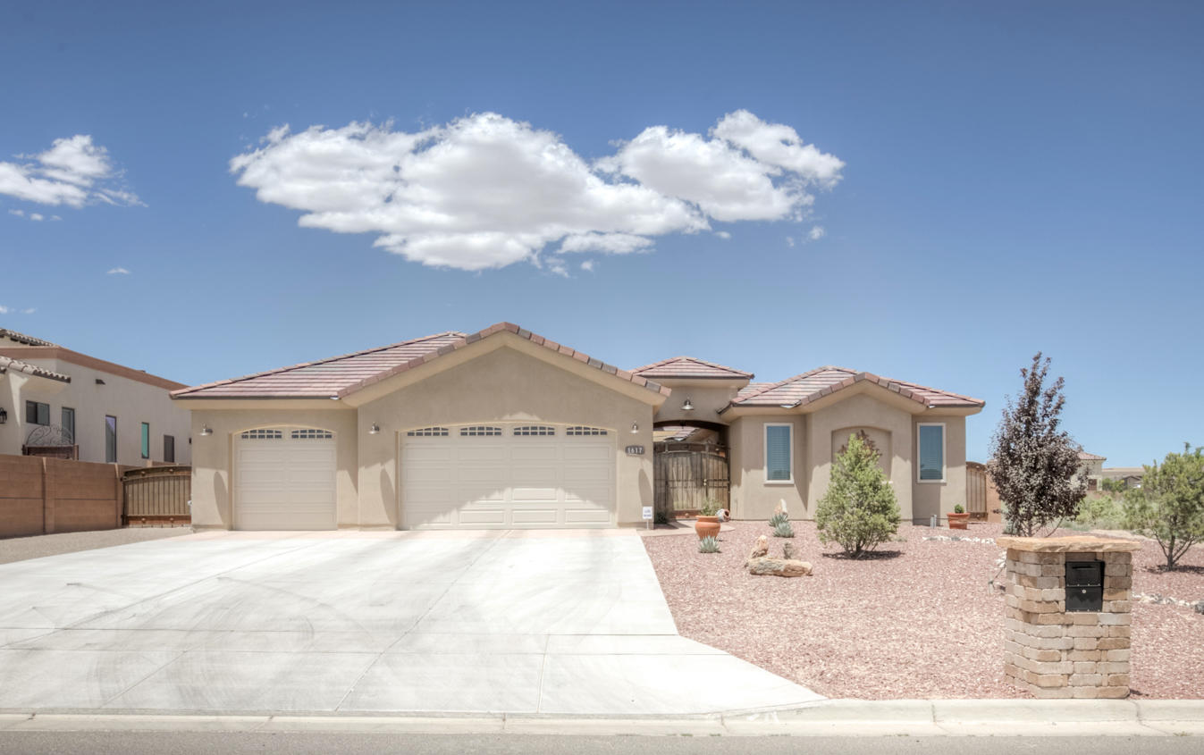 Stunning home with attached casita in Rio Rancho Estates!  Designed with energy efficiency in mind this like new home is situated on 1/2 an acre and features: Open floorplan, Chef's kitchen w/ huge island & high end granite, Great room w/ custom tiled fireplace, Large bedrooms w/ walk in closets, Master suite w/ double sinks, tiled shower & separate tub, Designer tile throughout, 3 car oversized, finished garage & attached casita w/ separate entrance, kitchenette, 3/4 bath & walk in closet.  The exterior features a beautiful, private main entry courtyard & landscaped yard complete with trees, covered patio and shaded seating area to take it all in!  All of this on public utilities, NO HOA & close to RUST Medical Center.  Don't miss this immaculate, meticulously maintained property!