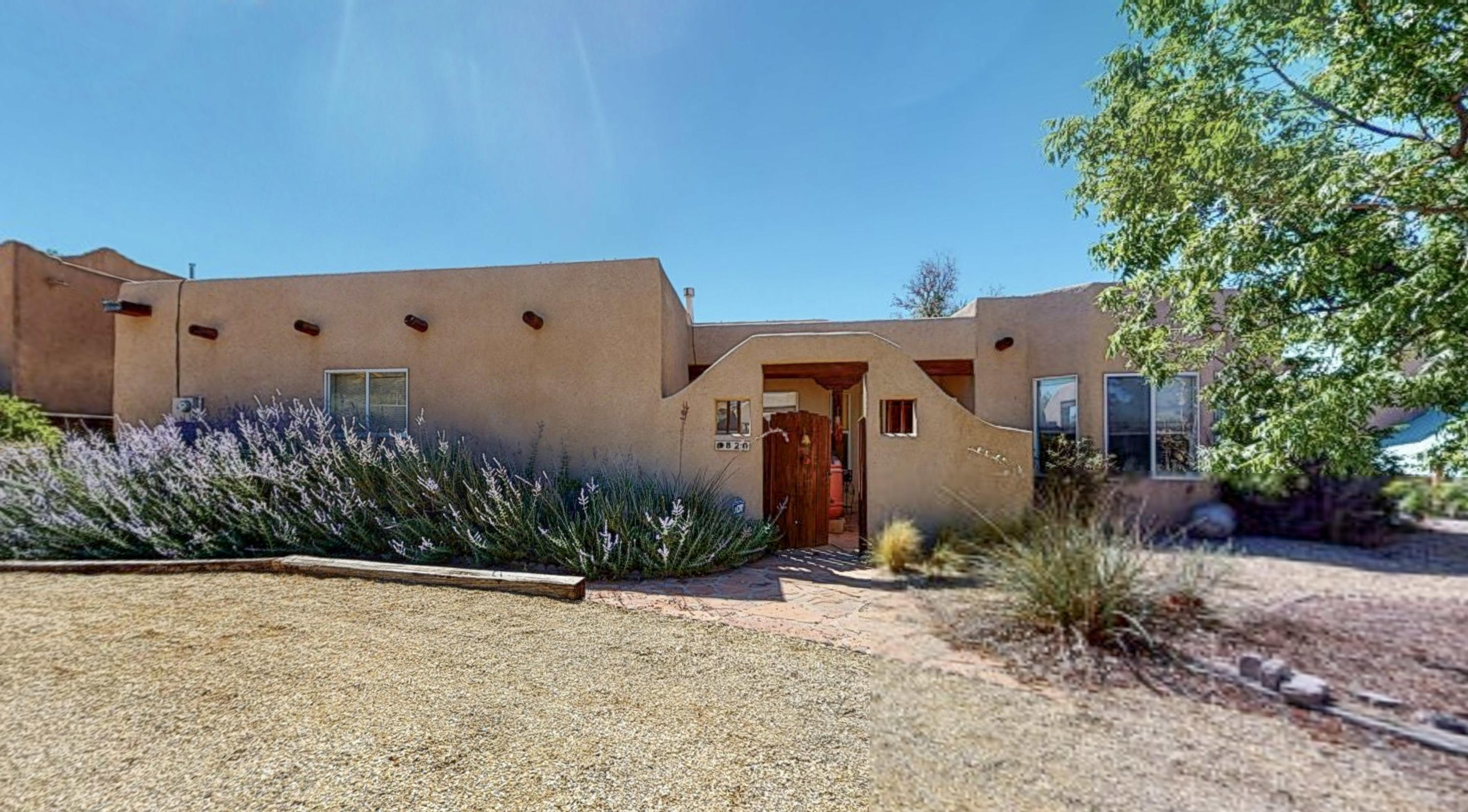 Exquisite Sandia Mountain Views from this property. Courtyard entry with a Circular drive and there is back yard access.  Half acre lot.  Ceramic Tile Throughout, Adobe Accents, Vigas, Kiva Fireplace. Large windows to capture those spectacular views.   Formal Dining, Nook in kitchen with custom painted cabinets.  Privacy Suite with large bathroom, Separate Shower and Garden Tub.Storage Shed, Gray Water Barrels, Large yard beyond wood fence with green house. Cleveland High District.