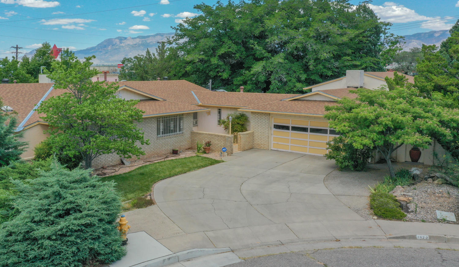 Looking for more room? This late mid-century modern, with classic touches and more built in cabinets than you can imagine holds true to its '60s retro vibe! The sprawling .388 acre corner lot with not one, but TWO, backyard alley access gates, one leading into the gated 720 SqFt RV parking and garage/shop.  24X30 shop even has its own separate evaporative cooler. This in addition to 2 car garage with extra storage and office. Kitchen was remodeled in the 90s with custom-built oak cabinets, newer Dacor glass ceramic electric cooktop, vent hood to exterior, newer Bosch dishwasher, enormous side-by-side SUB-ZERO refrigerator/freezer. Veggie sink and pantry, breakfast bar, and instant hot water. SEE MORE