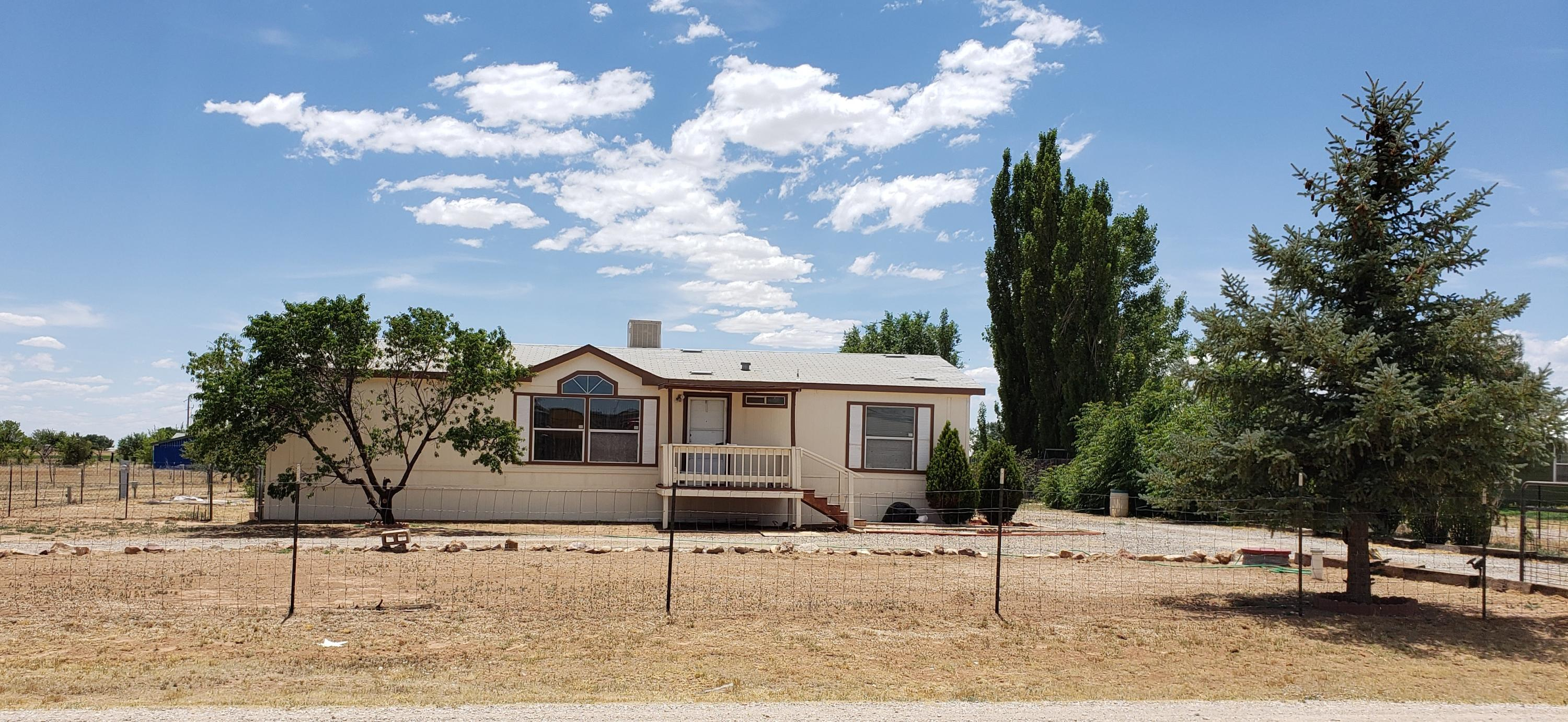 Super convenient, easy access to freeway and restaurants! Well maintained home, with new carpet, and new septic! Large his & hers closet in master with a large master bath featuring garden tub and his & her sinks! Easy access for RV with 2 gates!! This one won't last....