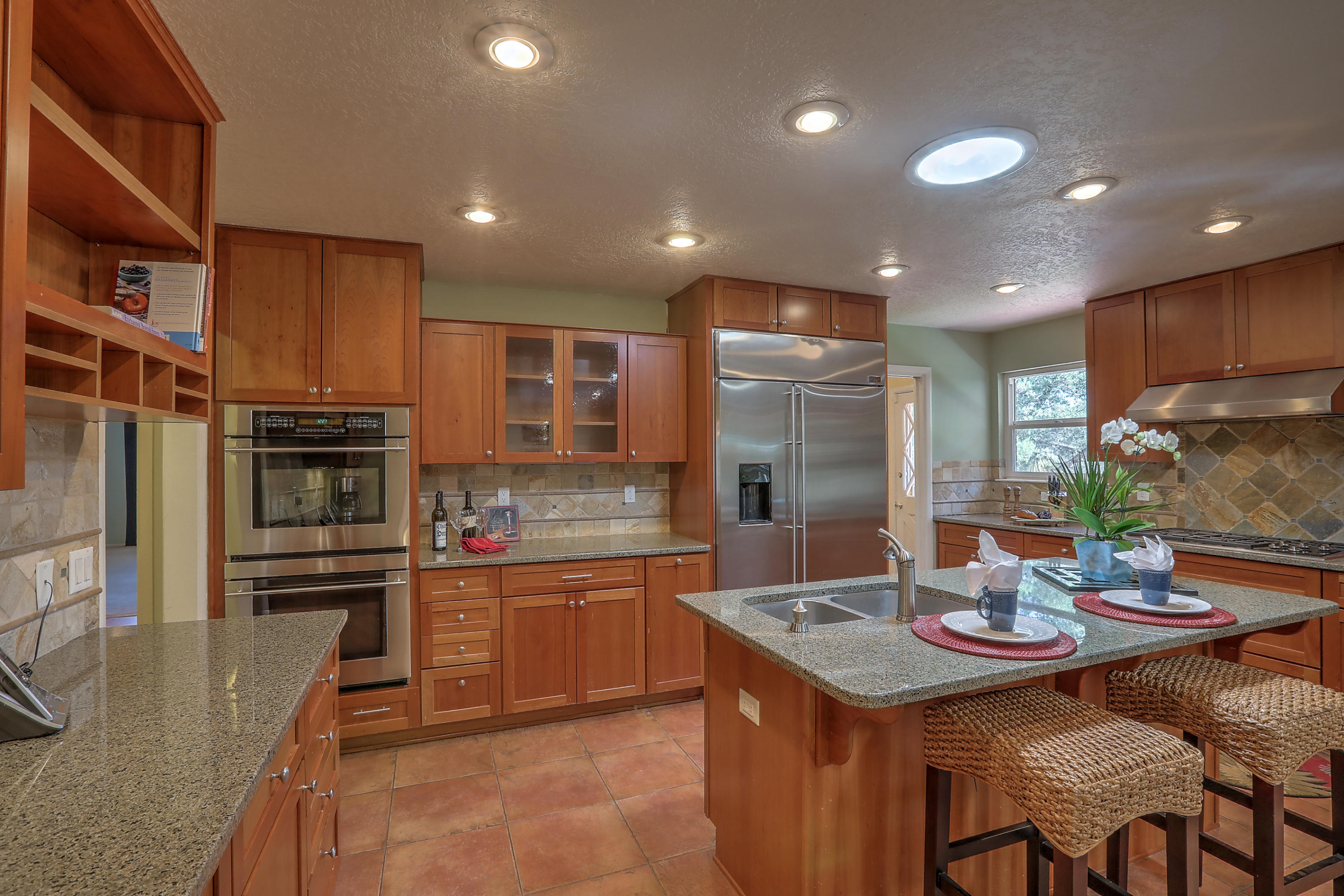 PRICE ADJUSTMENT ! Exceptional all brick family home in the Ridgecrest area featuring 6 bdrms, 3 baths. Ideal for an extended family, in-laws, guest rm, or home office. Remodeled kitchen w/ cherry cabinets, granite counter tops, Wolf cook-top stove , double ovens. walk in pantry. Lg family room and living room both with custom fireplaces and brick floors. Master suite is complete with sitting area, built-in bookshelves, wood burning fireplace, walk-in closet and access to a private patio. Don't miss the basement with plush carpet, extra storage and perfect area for a game room, media room or just a room to escape. Picture perfect back yard with large covered patio and mountain views. This is a fantastic family home in a wonderful location close to hospitals, downtown and easy access to  I-