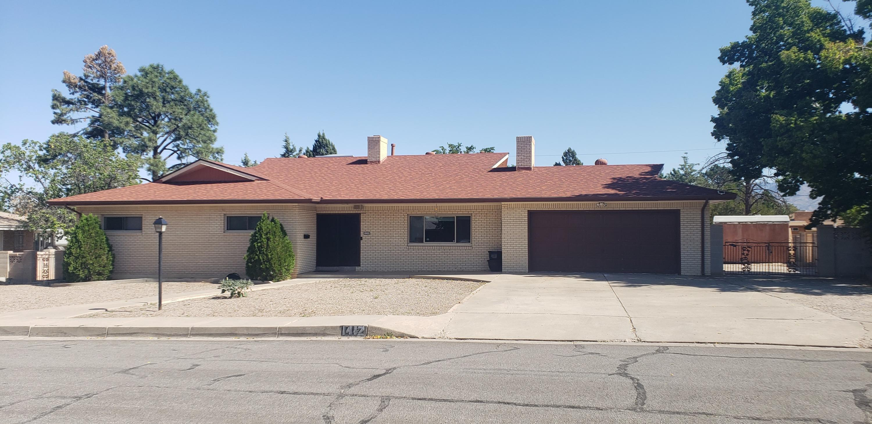 In the Desirable Siesta Hills Neighborhood all the expensive stuff is done! 2 Refrigerated air units and 2 furnaces (2016). Newer windows, New roof in Oct. 2018, 2 water heaters in 2016. 2 master suites or in-law quarters with separate entrance. 2 living areas, breakfast nook, and formal dining room. heated, enclosed sunroom. Laminate floors in living room and bedrooms. Beautiful tile from mexico in the rest. 2 Laundry areas, one in the kitchen and one in the utility closet in the living room. Backyard access with lots of concrete. Huge yard with basketball hoop. shade trees, and storage shed. All the bedrooms have ceiling fans. living room has vaulted ceilings and skylights  Needs a little TLC, but so much potential and all cosmetic, priced accordingly.