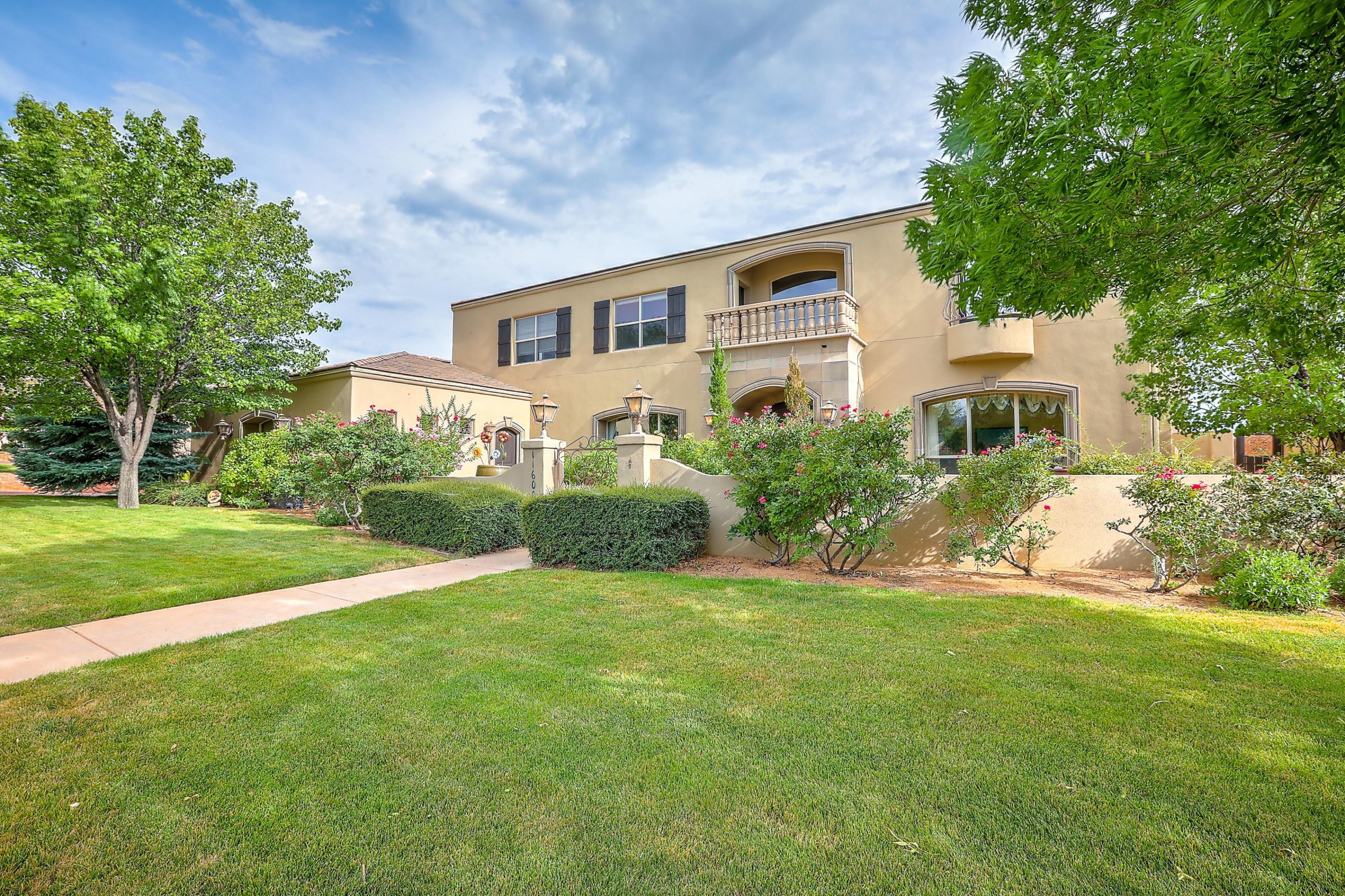 Nestled On Tanoan Golf Course in the Desirable Sauvignon Gated Neighborhood, Your Dream  Mediterranean Villa Awaits. Featuring Sweeping Incredible Views & Obvious Attention To Detail. As You Enter Through The Impressive CourtYard & Arched Wood Door To The Magnificent Entry Hall, Your Eyes Pause At The Sweeping Staircase & Are Immediately Drawn To The Window Wall Views Of the Expansive Back Oasis. The Chef's Kitchen Features Stainless Appliances, Cast Stone Surround WBFP, Two Bar Tops, Ice Maker, Warming Drawer & Kitchen Sink Window. Walk Out To The Back Deck W/New Automatic Awning Cover. The Master EnSuite W/Breathtaking Views Include A FP, Built Ins, Large Walk In Closet & Master Resort Bath. The Lower Level Game Room Overlooks Large Outdoor Covered Patio W/2 Way FP.