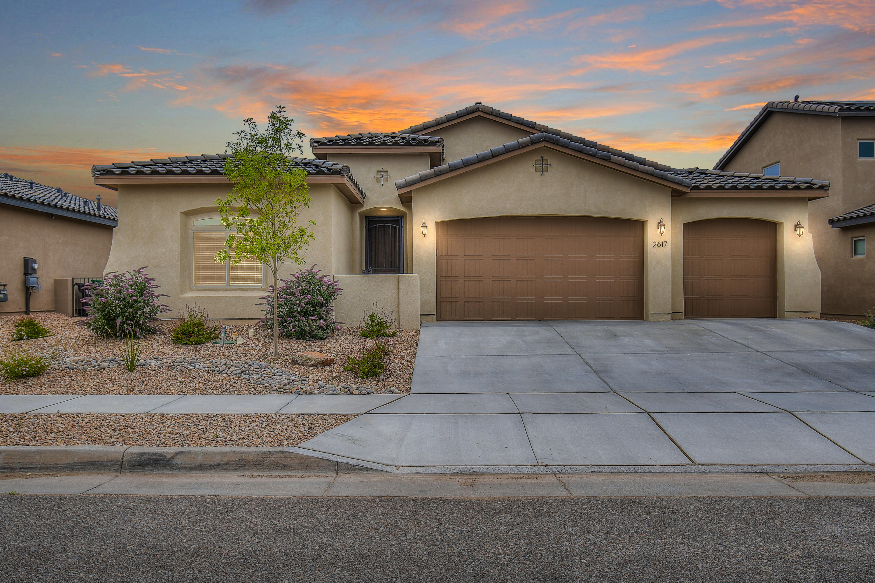Welcome to this almost new home in Mariposa in Rio Rancho! Front Entry w/skylight leads you into this 3 bed, 2.5 bath, 3-car garage home. Barn doors open to Study/Possible 4th bed. The kitchen features an island w/sink and task lighting w/seating for six. Upgraded cabinets, tile backsplash, stainless built-in appliances, and walk-in pantry make this a chefs dream.  Kitchen is open to dining room w/recessed lighting and plenty of windows for natural light. The great room features coffered ceiling, gas log fireplace, ceiling fan and expansive glass doors leading to the covered patio. Master suite features coffered ceiling with ceiling fan and huge walk-in closet. Master bath has double sinks, soaking tub with tile surround, separate water closet and walk-in shower w/frameless door.