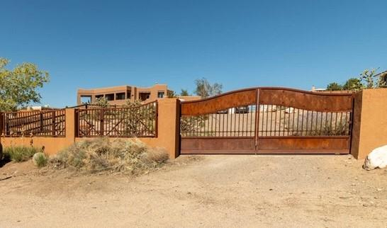 It's all about location and breathtaking 360 Panoramic Views with this gem. Bring your horses to this wonderful property. This home has a gorgeous gated entrance and lots of Southwestern charm including adobe walls and latillas just to name a few.