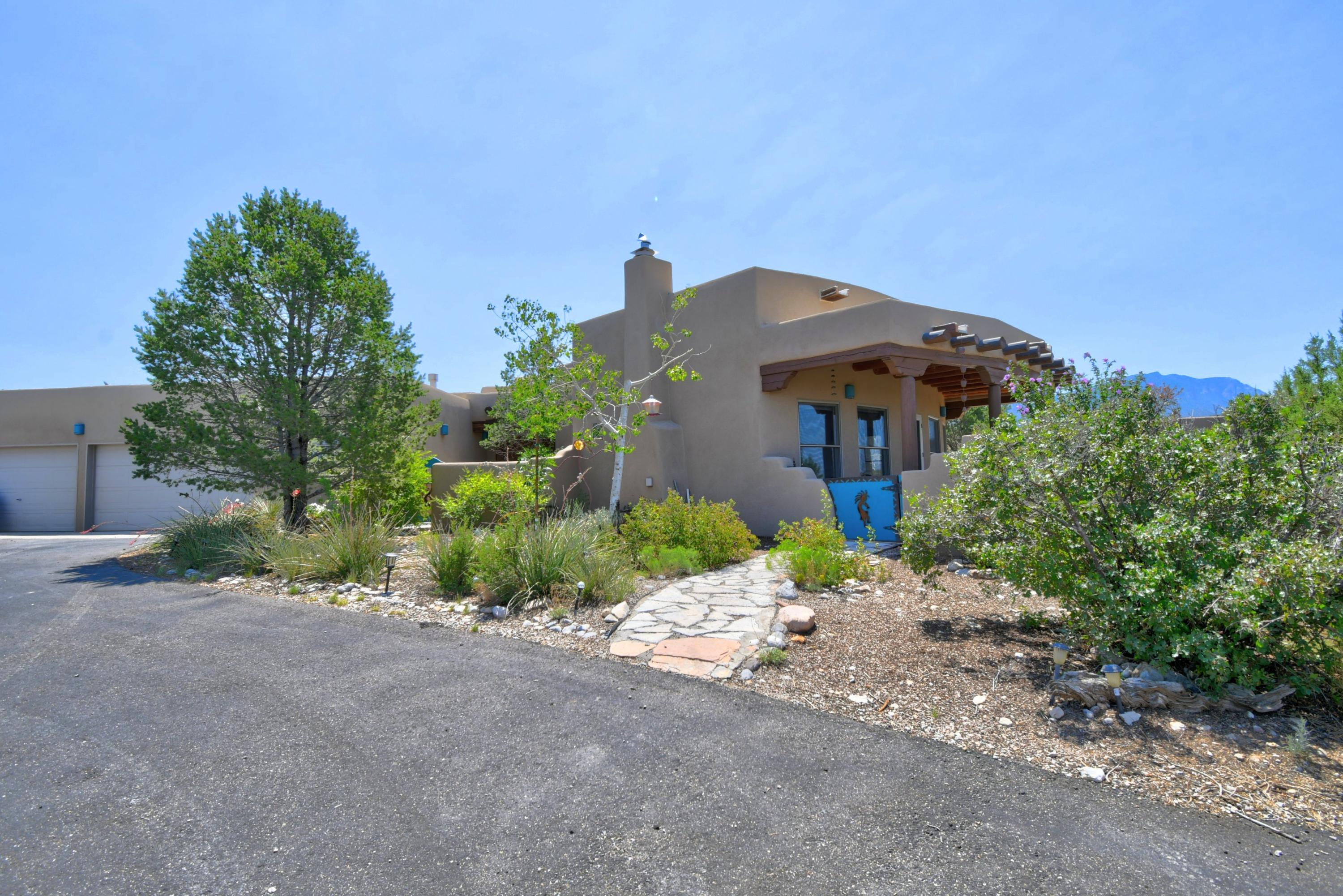 Two Master Suites make this stunning Santa Fe style home perfect for extended family. Incredible,expansive views for amazing sunsets!  Wonderful kitchen with dining room connected perfect for entertaining. Owners have made many great additions such as paving the driveway, newer roof 2017 and so much more! Placitas is known for its hiking and biking trails. Come see this beauty!