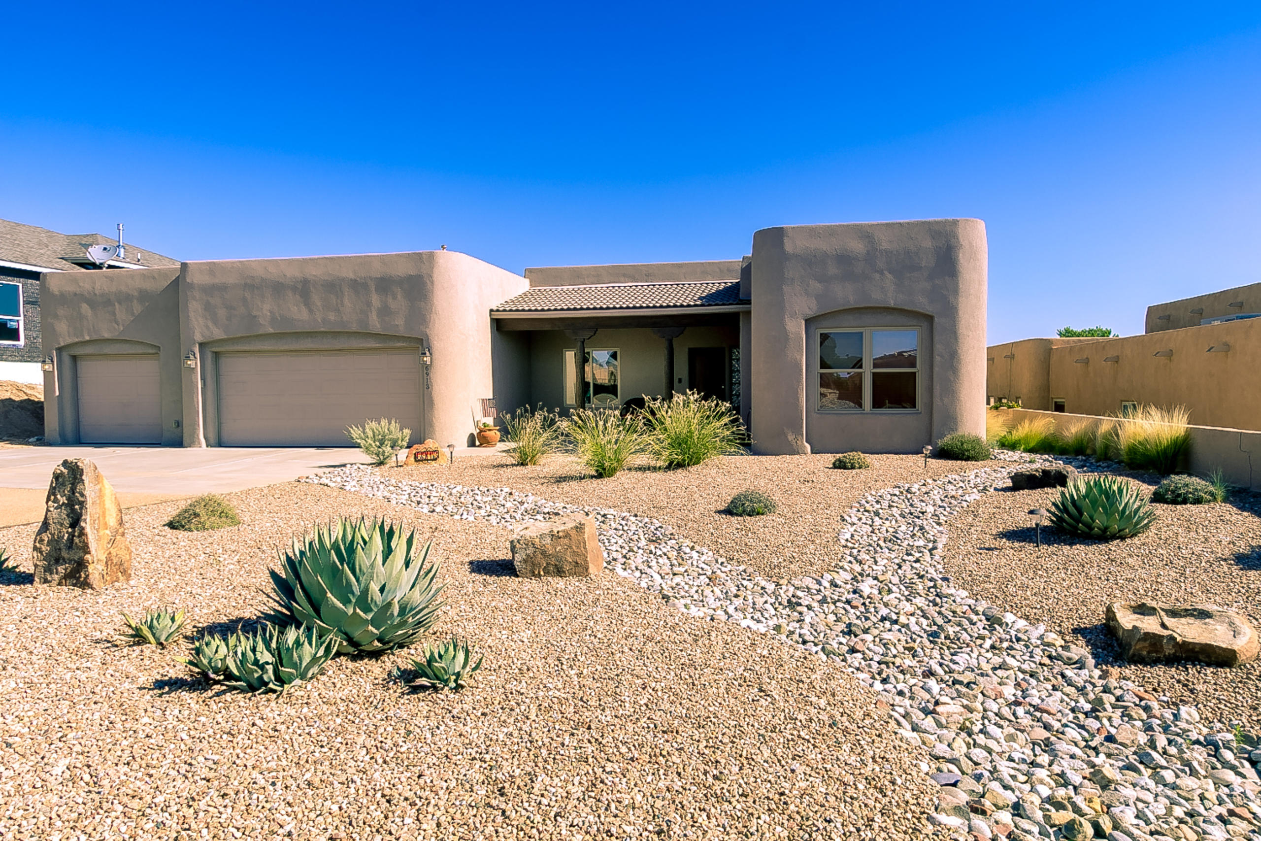 Impeccably Maintained One Story Home On A Half Acre Located in Rio Rancho Estates Views Galore! Numerous Windows To View The Beautiful Rio Rancho Landscape and Mountains. A Southwestern Flare With Wood Columns And Solid Wood Doors. Spacious Kitchen Has SS Appliances, Double Oven,Cooktop,Pantry, Granite Counter Tops And Breakfast Bar. Formal DR . Great Room With Beautiful Built In  Kiva Fireplace Four Bedrooms Which One Could Easily Be An Office/Study. The Spacious Master Bedroom  Has Two Separate Walk In Closets, Two Vanity Sinks, Separate Shower and Garden Tub.For Added Privacy It is Located on The Opposite Side Of The Home From the Other Bedrooms.Three Car Garage And Covered Patio. Refrigerated Air 2018 TPO Roof With Transferable Warranty The Market Is Hot! Request A Showing Today!