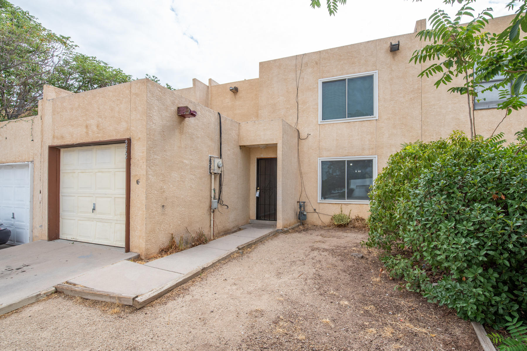 Move in ready Townhome. Freshly painted and new carpet Full of natural light.  3 bedroom , 2 bath, Living and separate dining rooms. Kitchen offers stainless appliances, good sized pantry, ample cabinets and counters. Fenced backyard for privacy. 1 car garage. No HOA.