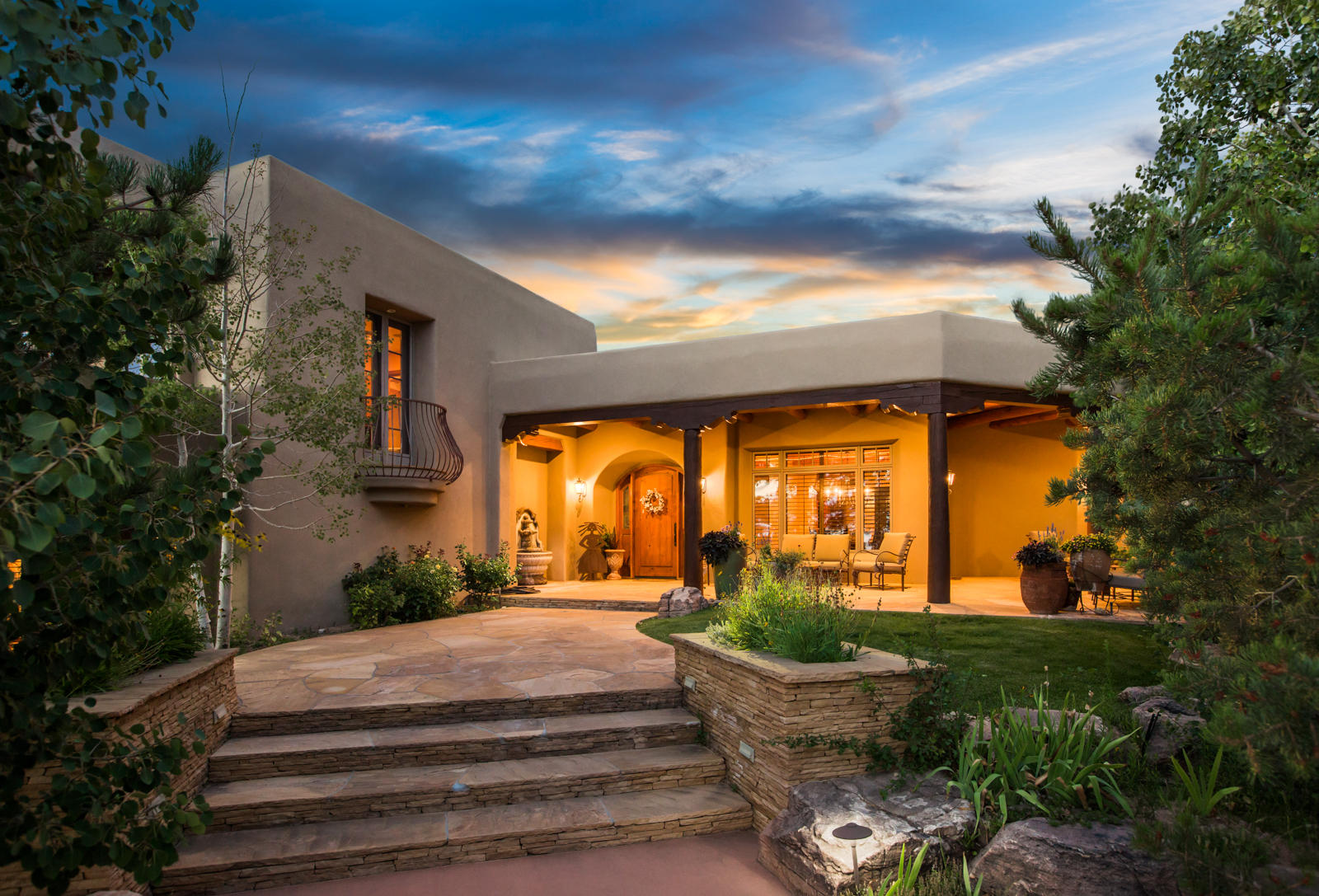 This spectacular residence was conceived by Richard Schalk and was designed to take advantage of the most spectacular views of the Sandia Mountains in Albuquerque. This home presents a rare and unprecedented opportunity to be on the only double lot in High Desert that backs on the national forest. Rich finishes were chosen by a talented interior designer and include hand trowled plaster walls, beautiful beamed ceilings, handcrafted doors, furniture grade cabinetry, and artisan crafted tile. This home is grand in scale, yet comfortable and inviting. Enjoy the most spectacular sunsets from the rear portals, and spectacular city lights from multiple portals. The outdoor living spaces consist of numerous covered portals, a sparkling pool, an outdoor fireplace and an outdoor kitchen.