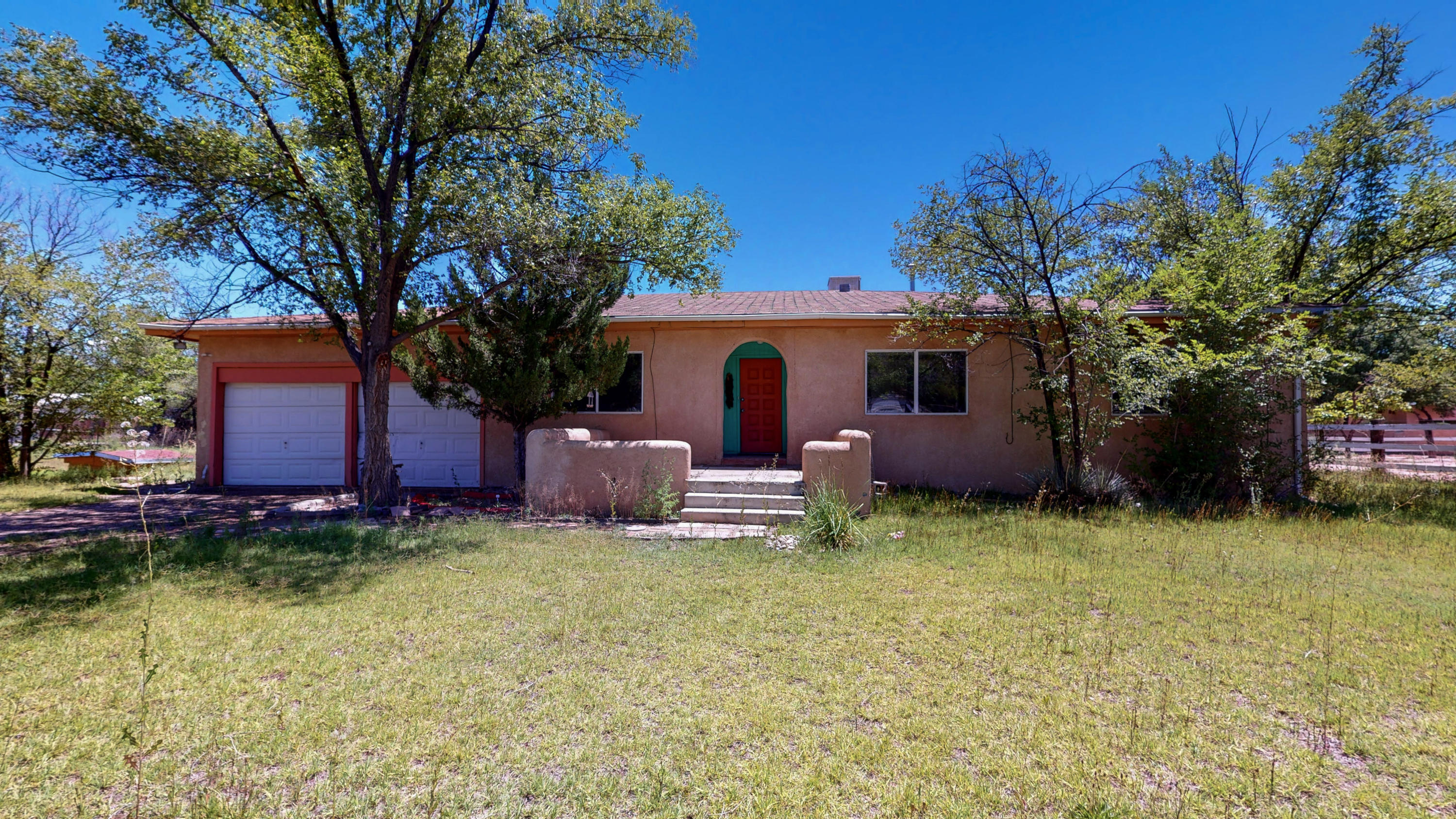 This great corner-lot property is one of a kind!  Spacious rooms, 2 living areas, fireplace and lots of New Mexican accents (wooden vigas, Southwestern color scheme).Almost one-acre of land!  This home needs a little TLC, but has tons of potential!