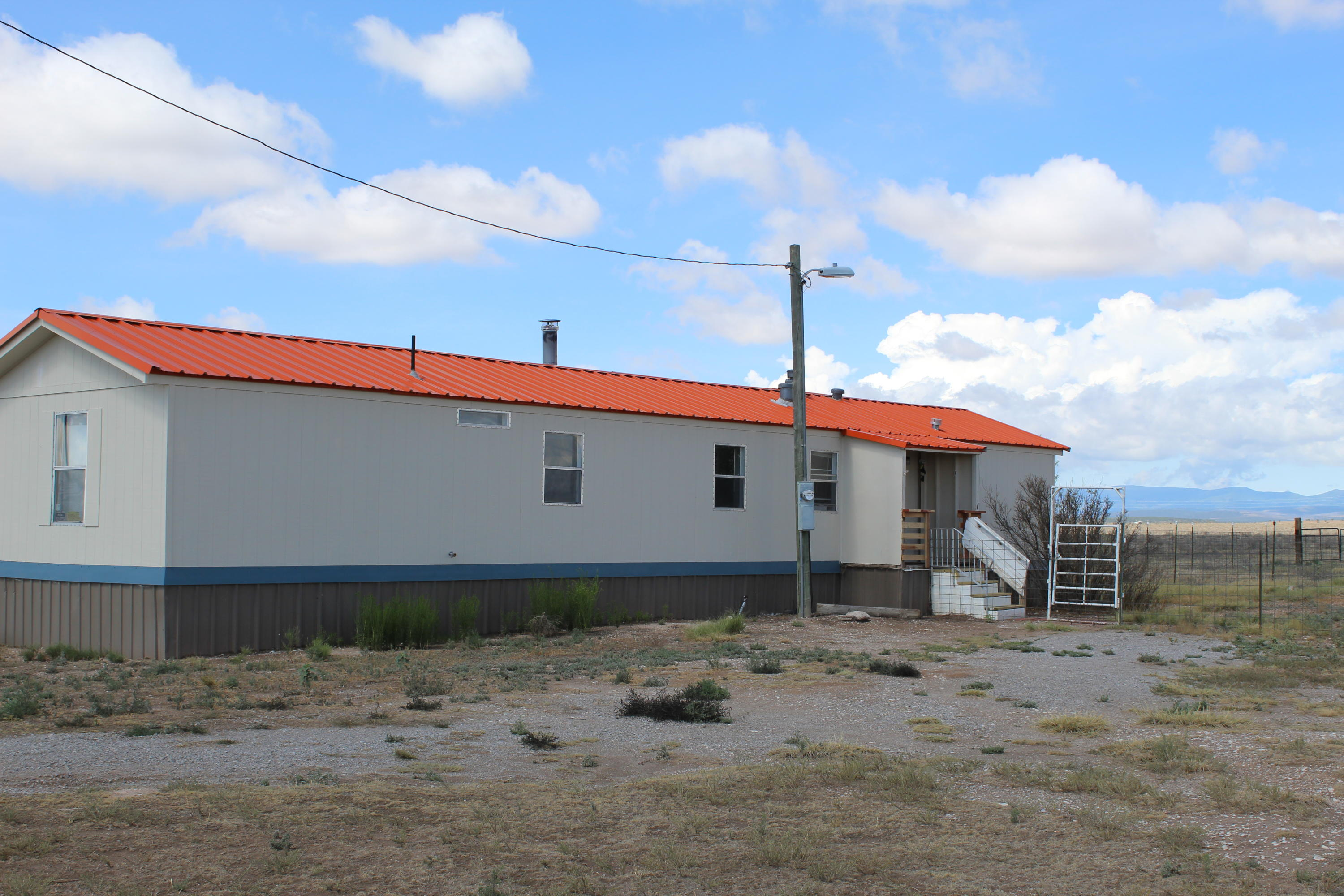This single-wide manufactured home on 20 acres near Estancia, New Mexico sits on two 10-acre tracts making for many possibilities...create a horse property, sell the second tract, develop and sell yourself, cultivate a large garden with the 3-acre feet of domestic water, use as a rental...you decide. The home is in good condition with up to date appliances, but is in need of new flooring throughout.  Two bedrooms and two baths. This country home with acreage is an easy drive to Albuquerque or Santa Fe.