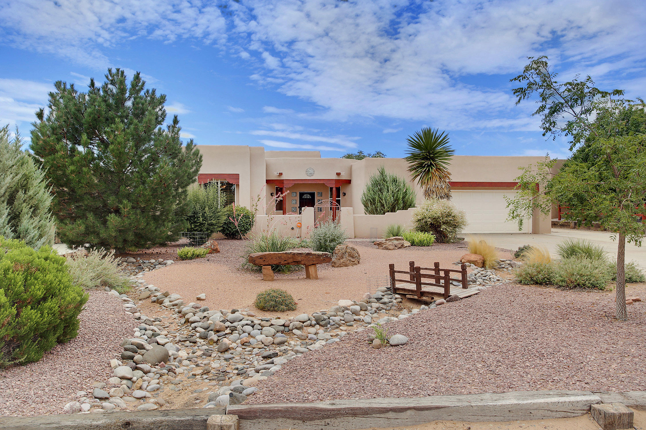 Million dollar views for under $500,000! This well built, beautifully maintained home sits on an outstanding .50 acre with incredible views of the Sandias.  Abundant natural light throughout and a lovely, open floor plan.  Kitchen boasts granite counter tops and stainless steel appliances. Stove is 1/2 electric and 1/2 induction and is also plumbed for gas.  Wake up in your owner's suite to amazing views!  This bedroom has an enormous walk-in closet and spacious bath. Great separation between owner's suite and additional bedrooms. The  home has refrigerated air -  seller-owned solar panels keep electric bill under $9.00/month. The garage is oversized and finished.  Need a place to park the RV? The paved RV parking has 50amp electrical service available. Click More for additional info.
