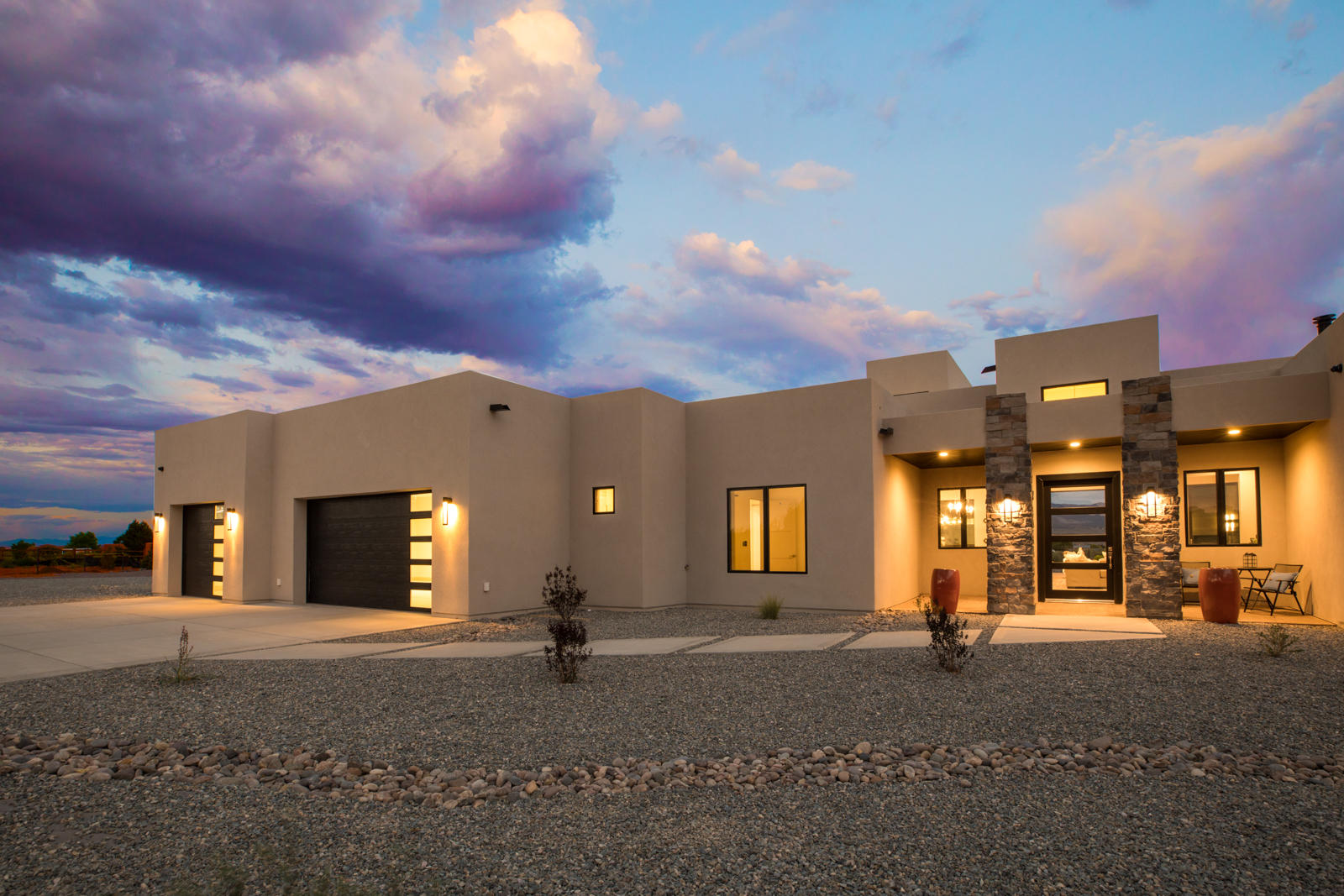New custom-built home in Corrales; stunning views of Sandia Mountains and sparkling city lights.  One acre lot fenced in w/security gate, open floor plan with wall of sliding glass doors to the covered 1200 sq ft patio; built-in grill, fireplace and skylights.  Kitchen is a chef's heaven with an oversized island, butler's pantry & Thermador appliances. Master has awesome views, walk-through shower, tub and walk-in closet. 4 spacious bedrooms with baths and walk-in closets and home office w/views