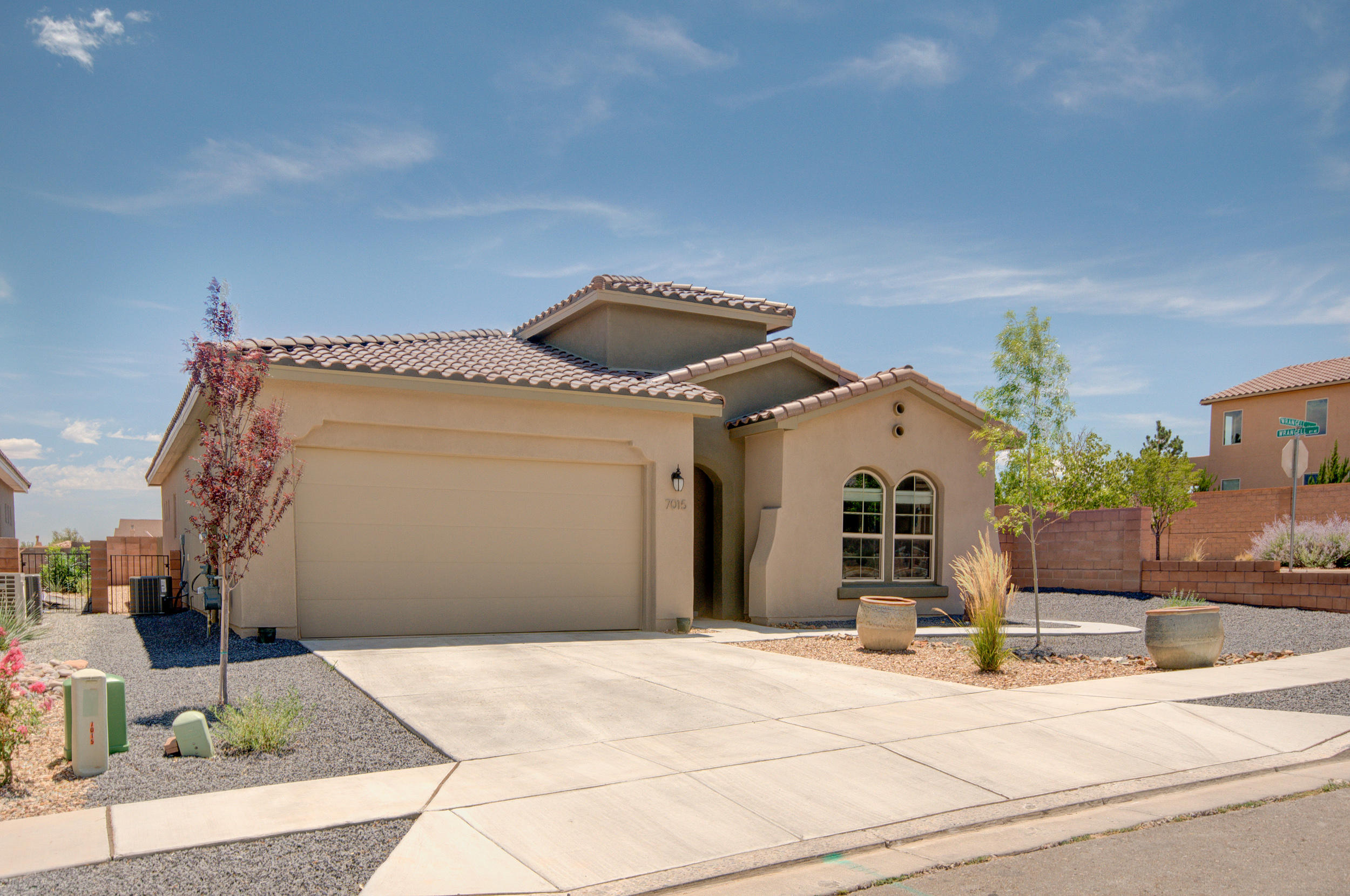 Corner lot with Mountain Views! This Beautiful 1 year old Hakes Brothers Home located in the Lomas Encantadas neighborhood features $60,000 in upgrades. Gourmet kitchen with beautiful white cabinets, granite counter-tops, tile backsplash, Whirlpool appliances, quartz stacked stone, oversized Island with 4 person seating, fireplace, tile flooring throughout the home. Navien instant hot water. Open floorplan perfect for entertaining. Tray ceilings in living room and master. 9ft ceilings in bedrooms and 12 ft ceilings in the living, kitchen, and dining room. Master suite with private bath, dual sinks, a large walk-in shower with tile surround, linen closet and large walk-in closet! Outside enjoy the extended covered patio with dog run! Schedule a tour today as this home will sell quickly!