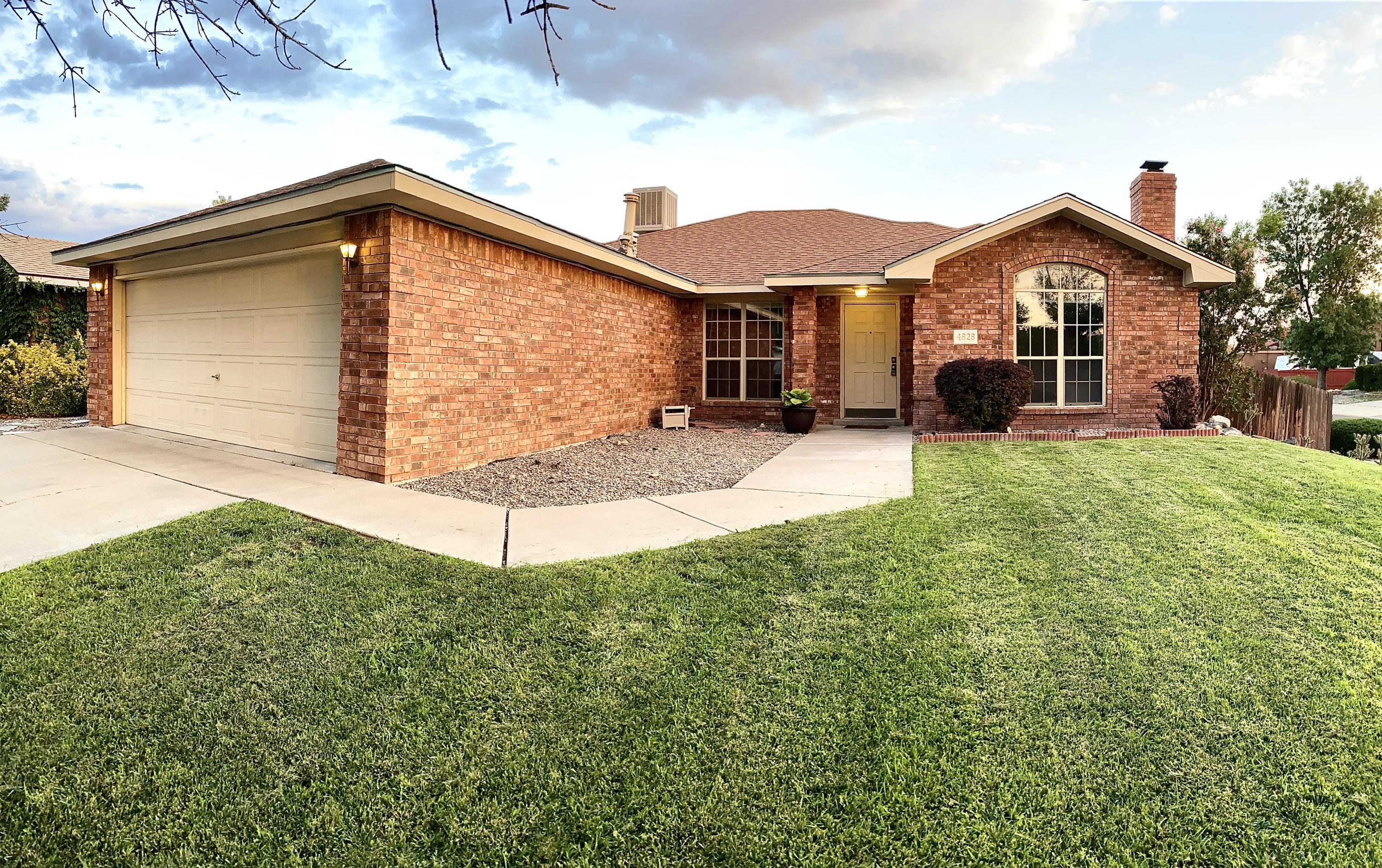 Beautiful Taylor Ranch home in Prairie Ridge. Pride of ownership and attention detail abound in this Opal Jenkins home on a large corner lot. Updated Kitchen and lighting with a designer touch. Large island and breakfast nook that opens to the wonderfully landscaped back yard and patio. This home has cathedral ceilings, arched panel windows, and a spacious great room with wood burning fireplace. Finally, the mature landscape with apple tree, roses, grass and garden feel provides an amazing backyard get away!