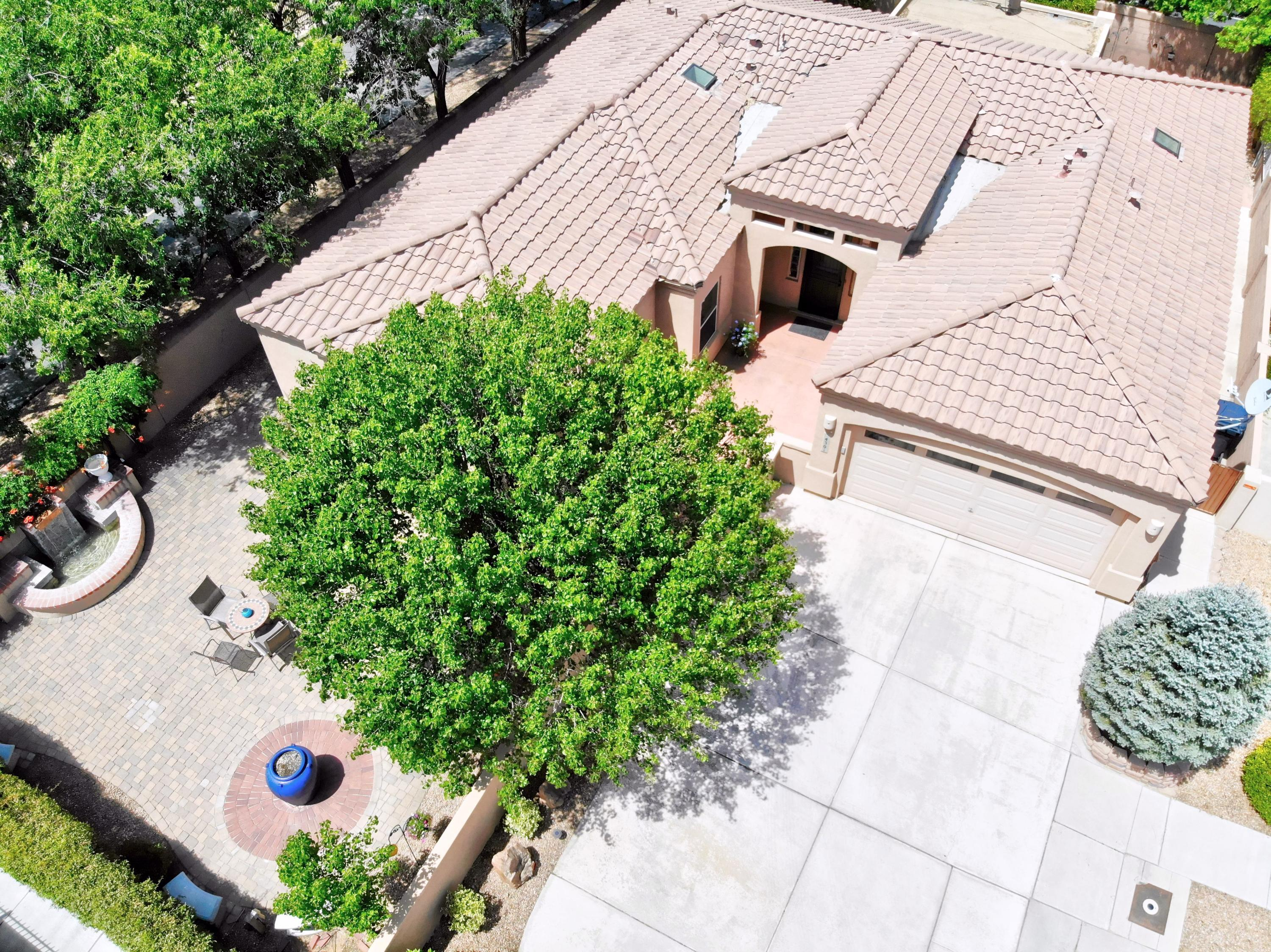 Gorgeous, enchanting large corner lot in Oxbow North gated community. Upon entry into courtyard gate you will find lovely outdoor entertaining areas w/fountains, shade trees, flowering shrubs & lush lawn. A lovely one story home w/wonderful floor plan perfect for home office or multi-gen living. Features include bonus room w/separate entrance, great room w/gas log fireplace, nook, SS appliances to include a Thermador gas range, beautiful cabinetry & large pantry in kitchen. Picture windows bring outdoors in, owner's suite w/2 walk-in closets, dbl. sinks, garden tub/separate shower, secondary bedrooms situated down hall & 3/4 bath, incls. a perfect room for in-law suite w/ it's own sitting area. Also, lots of storage, covered patio, gas stub out for BBQ, updated laminate flooring, & nichos.