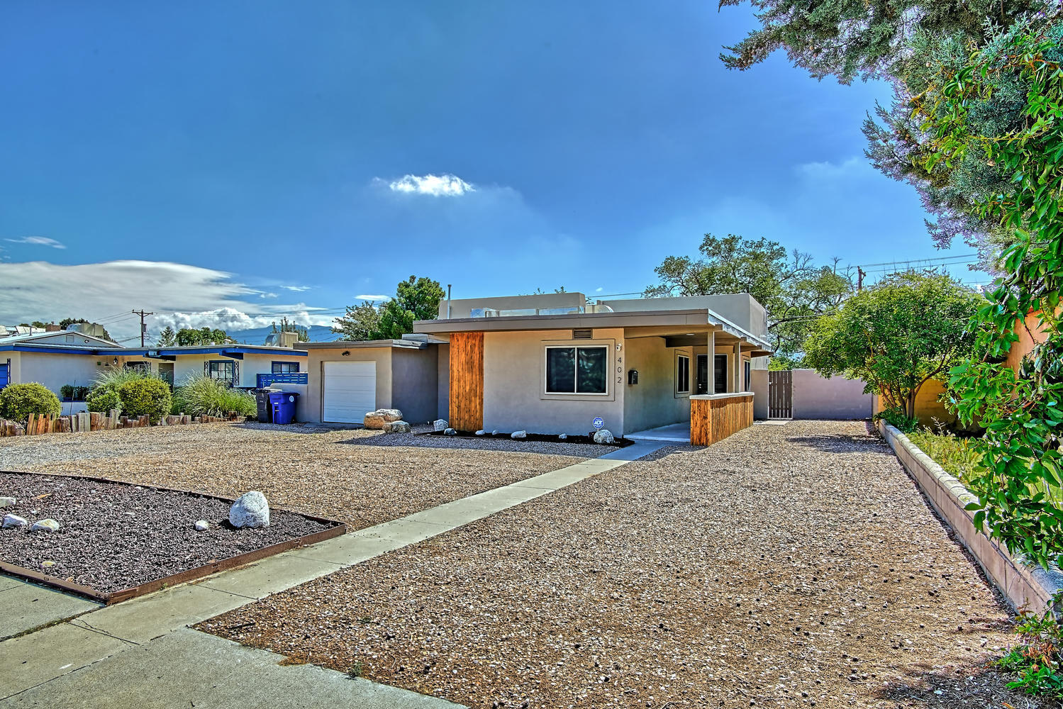 Absolutely Phenomenal complete NEW Build/Remodel in 2019!  UNM/cusp of Nob Hill Location!  OPEN, CONTEMPORARY and BRIGHT! Stunning Hardwood floors! Spacious LR/DR combo flows to Gourmet Kitchen w/Abundant cabinetry*Granite counters*SS GE-4 burner gas+griddle Range*Fab Decorator range hood*Large W-in pantry! Beautiful lighting throughout including decorator ceiling fans! Luxurious Owner's suite boasts hardwood floors*A.M. sun* W-in closet w built in's* Relax in your Elegant soaking tub or custom shower! Modern double vanity w floating cabinets! 2 spacious BRs share a Gorgeous bath! Back yard access alley for RV or  Boat parking!  22k+ in recent amenities! Designer Energy efficient Steel Screens offer Privacy+ Security!  Xeriscaped yard! Mountain Views! Highly desirable and  convenient area