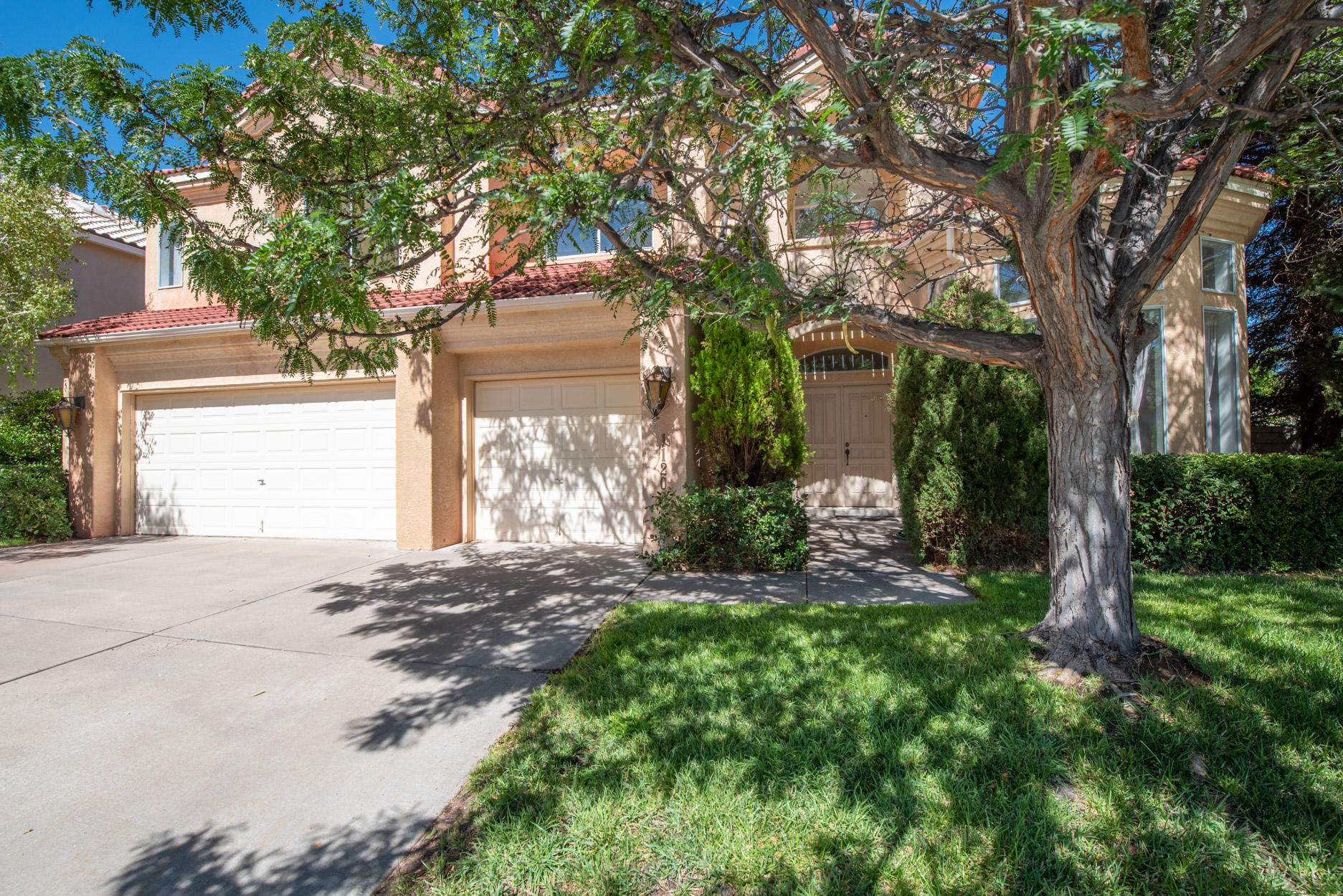 TANOAN EAST-CORNER LOT! 5BDR/4BA/3CG featuring an open floor plan & 2 living areas! Beautiful windows abound with lots of natural light! UPDATES include two evap coolers! Two new water heaters! New gas cooktop & disposal! Living room & family room with fireplaces. One bdr/study/office on the main level! Kitchen features a new gas cooktop, an island, a built-in wall oven, tile flooring, a walk-in pantry & spacious breakfast nook. Large secondary bdrs with walk-in closets and one bdr with its own private bath makes a great guest suite! Owner suite features a balcony, fireplace, his & her walk-in closets, dual sink vanity, separate shower and garden tub! Private backyard features a beautiful pond, grass, trees & shrubs and a covered patio for outdoor living! Private gated community of Tanoan!
