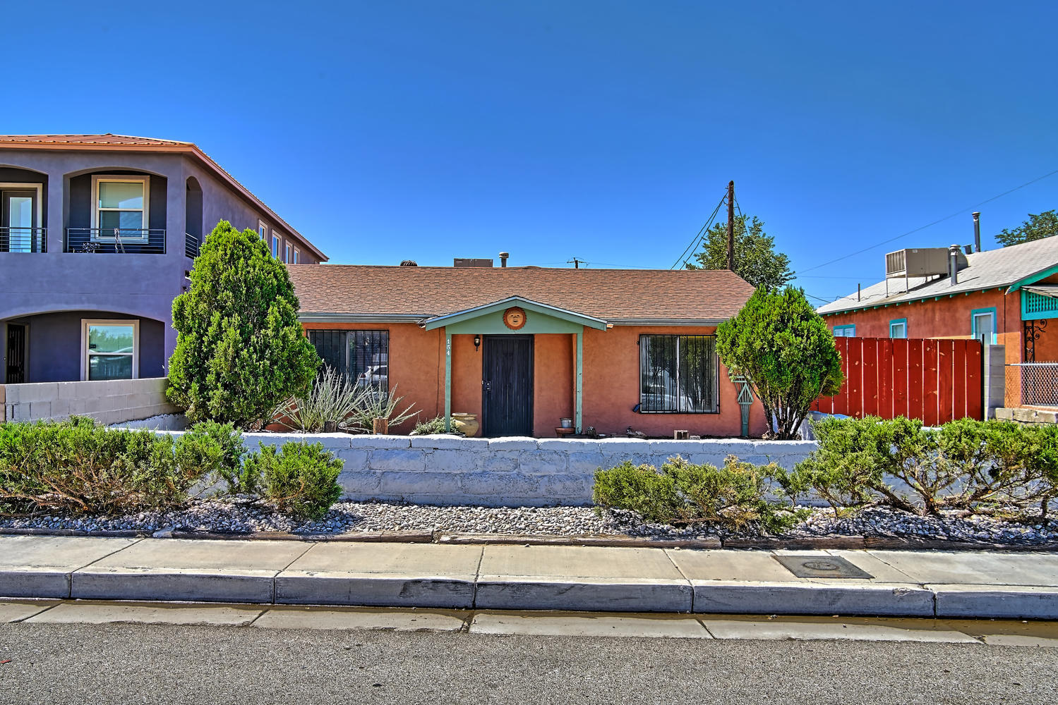 Warm and welcoming partial adobe home in North Valley.  Adobe built in 1946 with frame/stucco addition in 1980's. Superb side yard access on this .22 acre lot with large 2 car carport.   Lots of room for gardening.  Living room/dining room looks into a kitchen w/enough room for the entire family to cook together, plenty of counter space! Tons of cabinets too!  Breakfast bar on one end so one can  keep the cooks company.  Large can pantry adjacent to utility room which can accommodate a freezer as well as the washer/dryer.   Good storage throughout home.  Roof, furnace and Master cool were replaced approximately 12 years ago.  Stucco was recently redone.  Home is being sold in ''AS IS''  condition & needs updating.  Zoned R-M which allows for other uses.  Valley walking/biking trails.