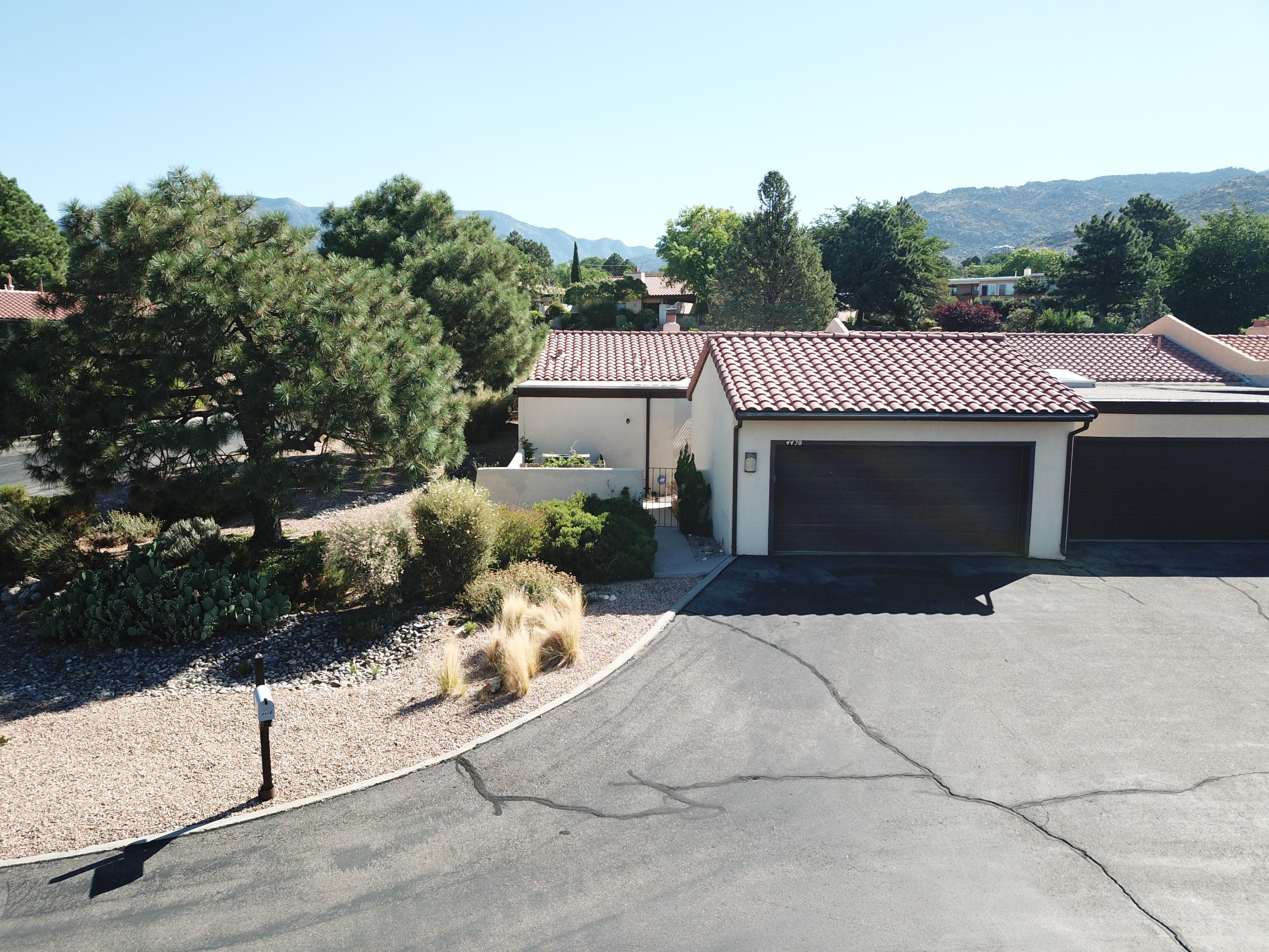 Come see this great home located in the foothills. View of the Sandias from your back patio. Kitchen is complete with granite counters. Two living rooms with custom two way fireplace. 2 or 3 bedroom(one is currently being used as an office. Refrigerated A/C, large bedrooms and a two car garage. HOA covers water, sewer, garbage.
