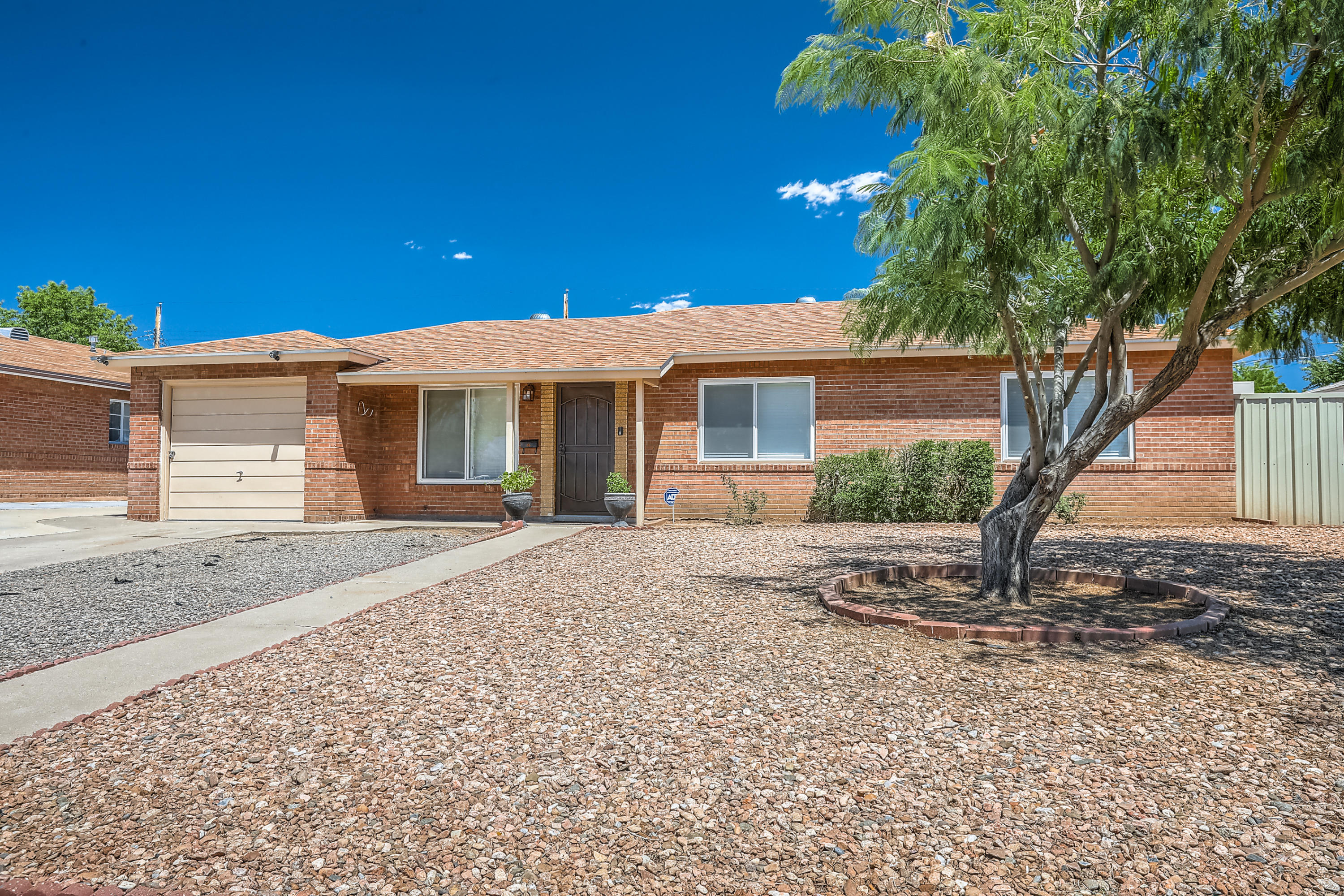 Wonderful Single story home located in the NE Heights with updated kitchen and flooring!. Home also features - 3 bedrooms, 2 baths and large spacious backyard with patio.