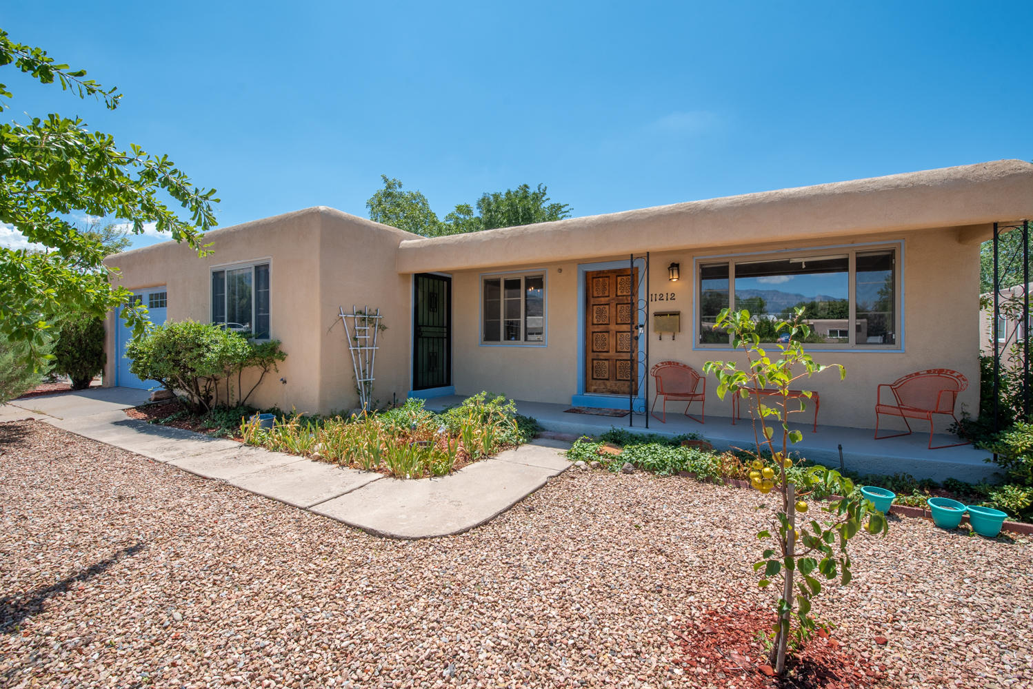 Great home in NE heights.  Lovely remodeled  kitchen with Quartz Countertops, remodeled laundry room, new Dishwasher, water heater and garbage disposal (2020), Newer Microwave, Range, Hood Vent, Washer and Dryer (2017), Newer roof, electrical panel and REFRIGERATED AIR (2017),  Trees: 2x Mature Pomegranate Bushes, Mature Pecan, Apple and Almond trees, Young Pear tree, 2 lockable sheds in back: 1 single level, 1 tall ,with loft, 6 large garden boxes, Newer energy efficient windows , Front and back porches refinished with non-slip paint, Front-side door upgraded with better door and a security gate added, ADT security system installed with sensors on nearly every door and window. Lockable storage closet in hallway with lots of extra shelving. Nest Thermostat & Ring Doorbell. Must See.