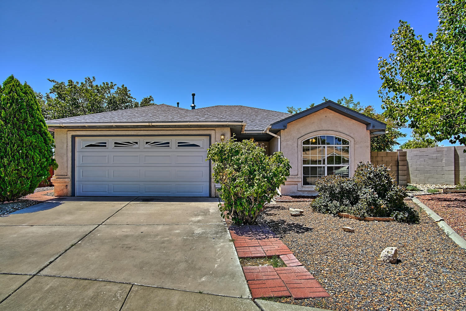 Absolutely wonderful Upgraded and Updated home ideally situated adjacent to Open Space! Over 20k in recent updates! New roof in 8/2019! Recent HVAC REFRIGERATED air combo! Recent paint/carpet! Recent Stainless steel Whirlpool 5 burner gas range+microwave! Inviting Living room featuring cathedral ceiling*gas log FP+decorator Tile Hearth! Sunny Kitchen boasts abundant cabinetry with a pantry cabinet! Bay window dining area/Tile counters and floors! Owner's suite offers shadowbox ceiling*decorator ceiling fan*walk in closet! Owner's 3/4 bath has Tile flooring*dual sinks*walk in shower!  2  bedrooms on the west side of home, both with ceiling fans! Home lives larger than actual SqFt. Wonderful outdoor living in large backyard! Adjacent to ABQ Open Space with walkways/bike paths!