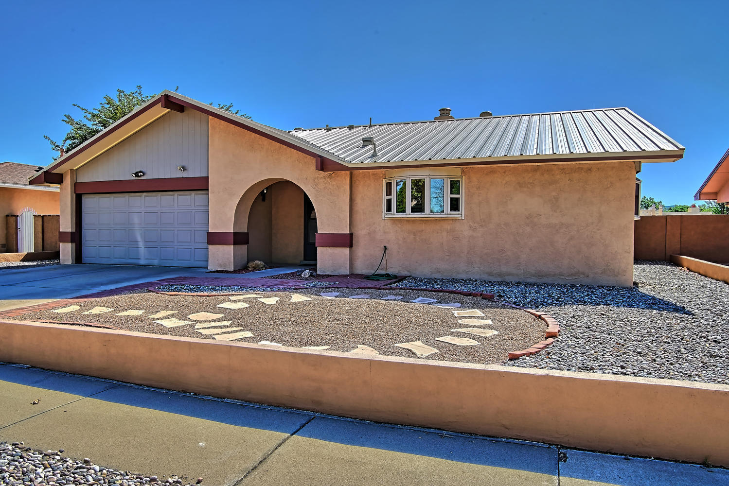 This warm and cozy home has everything your discerning buyer needs. The living room features a wood-burning fireplace and plenty of room for casual entertaining. Bedrooms are spacious and refrigerated air conditioning keeps the whole house nice and cool at this time of year. Other improvements include newer flooring, heater & A/C and windows.  The metal roof was installed in 2010. The entire property requires very little maintenance and the over-sized backyard shed is a big plus. This listing feeds to Volcano Vista HS and is conveniently located close to most everything.
