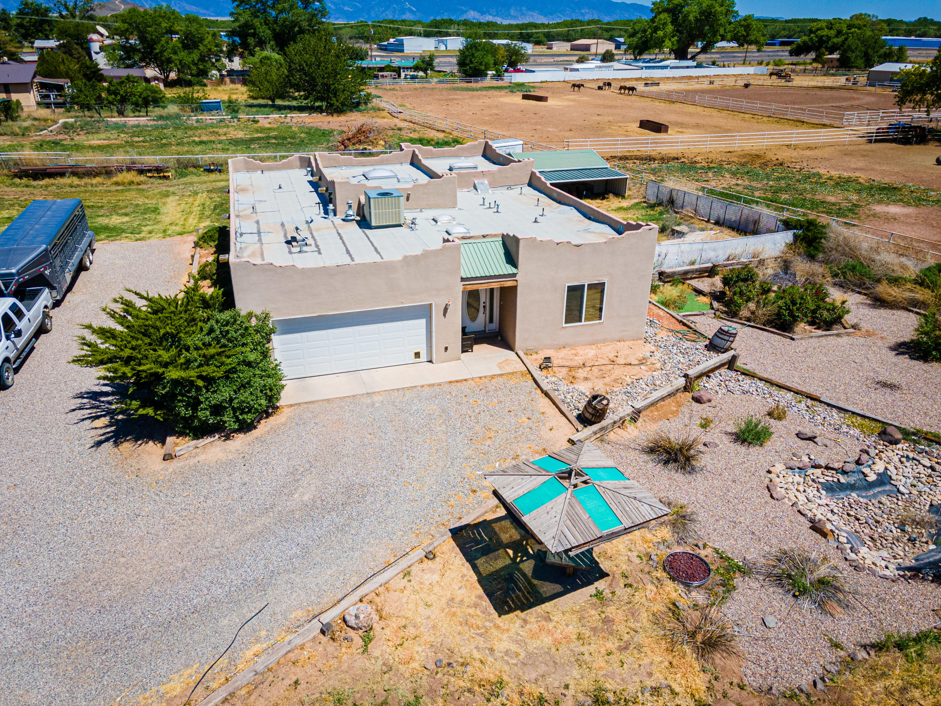 Beautiful custom home on 2 acres located in a convenient Los Lunas location! This property has so much to offer-- it sits on a coroner lot, has great use of outdoor space with a detached shop that includes 220 electric, barn, horse stalls and plenty of space for grazing livestock. Inside the home you will find a large kitchen with a breakfast bar, tons of cabinets, spacious living room with skylights and a sunroom off the back. Southwest accents throughout the home, large bedrooms, refrigerated air, radiant and central heat. Don't miss out, call to schedule your showing today!