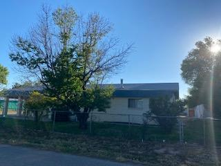 It's all about location in desireable Bosque Farms situated on a 1/2 acre, lots of space,  out buildings and storage. Come and see this perfect starter home or rental property today.