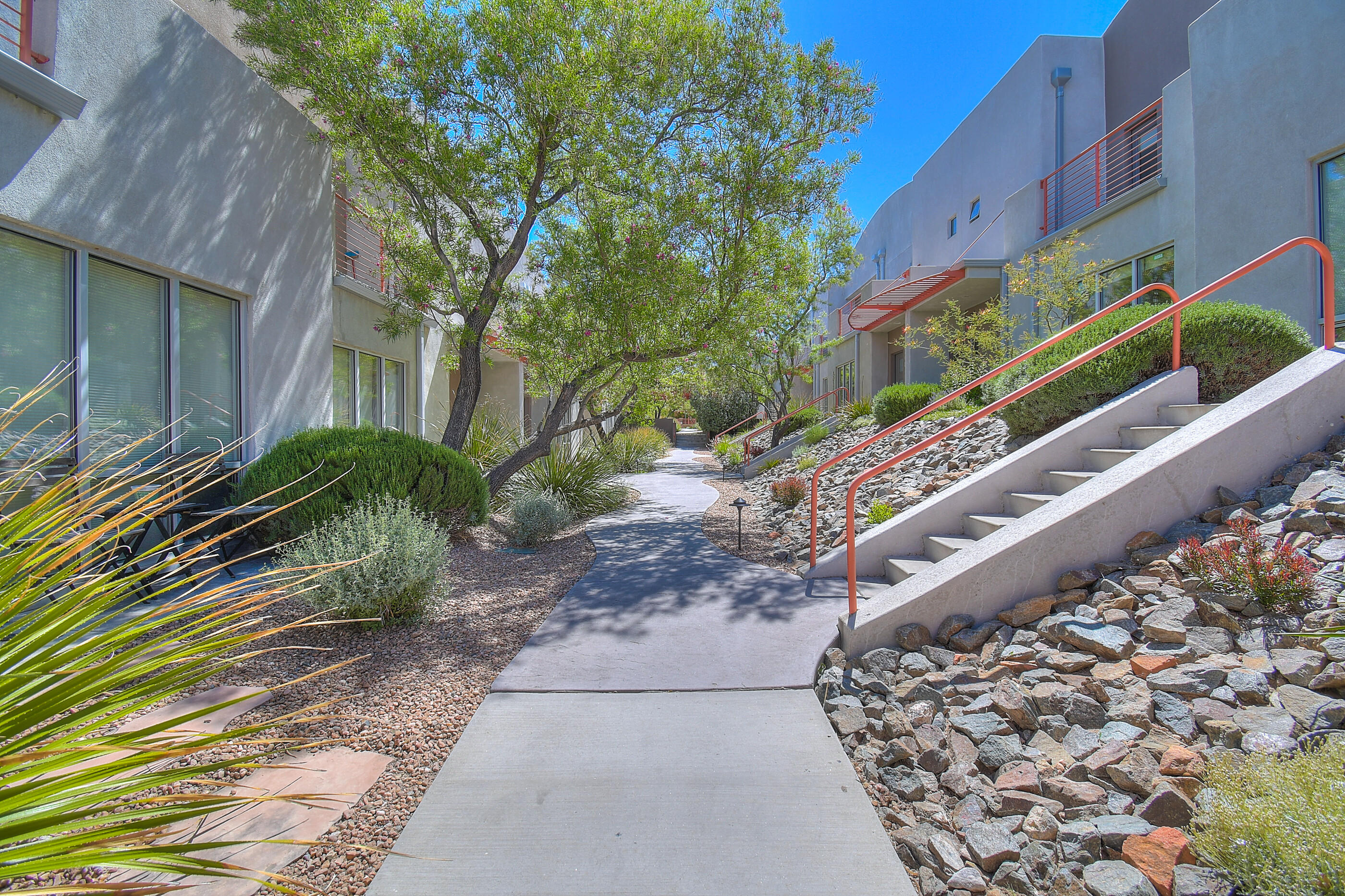 Location! Location! Location! Situated just one block off of Central in the heart of Nob Hill, this townhouse has it all! Gated community for privacy, two car garage, private community courtyard and two balconies. Step through the front door to contemporary living with an airy living area, open kitchen with granite counter tops, a sizable dining area, and a charming half bath for convenience. Beautiful french doors lead to a private exterior patio area- great for entertaining. Upstairs there are three spacious bedrooms, a large built-in book shelf and beautiful bathrooms with granite countertops. The spacious master is light and bright and has its own balcony. Organization is breezy with the beautiful California Closet system. Don't miss your opportunity to live in this desirable community