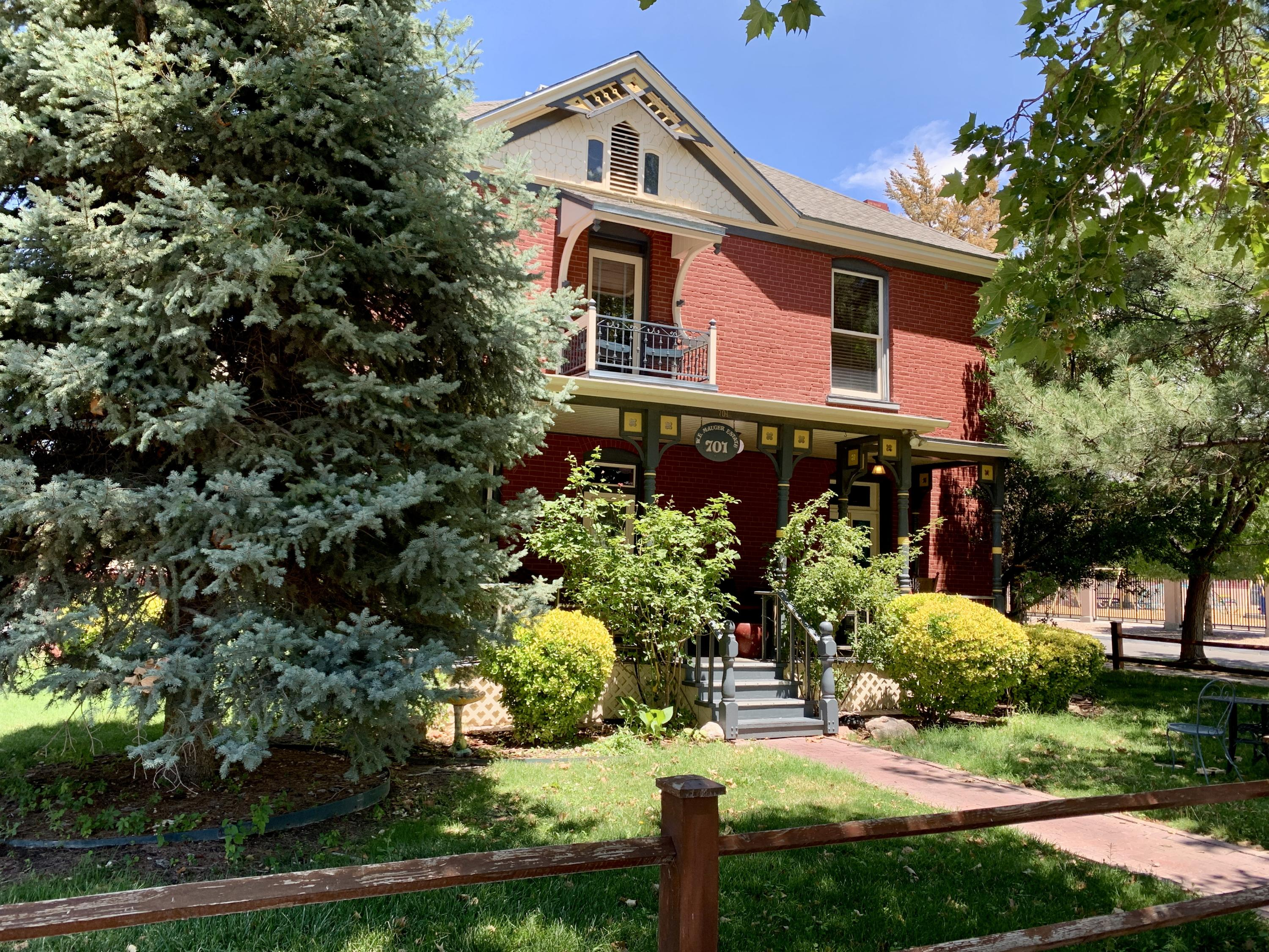 Rare opportunity to own a piece of Albuquerque History! Reside in your own downtown mansion, or use as excellent income generating investment opportunity. Can be purchased as furnished turnkey business or residence. Airbnb investors look no further. Home has contactless check in options for each room, private baths, shared kitchen and dining area. Huge parking lot, tasteful and easily maintained landscaping.