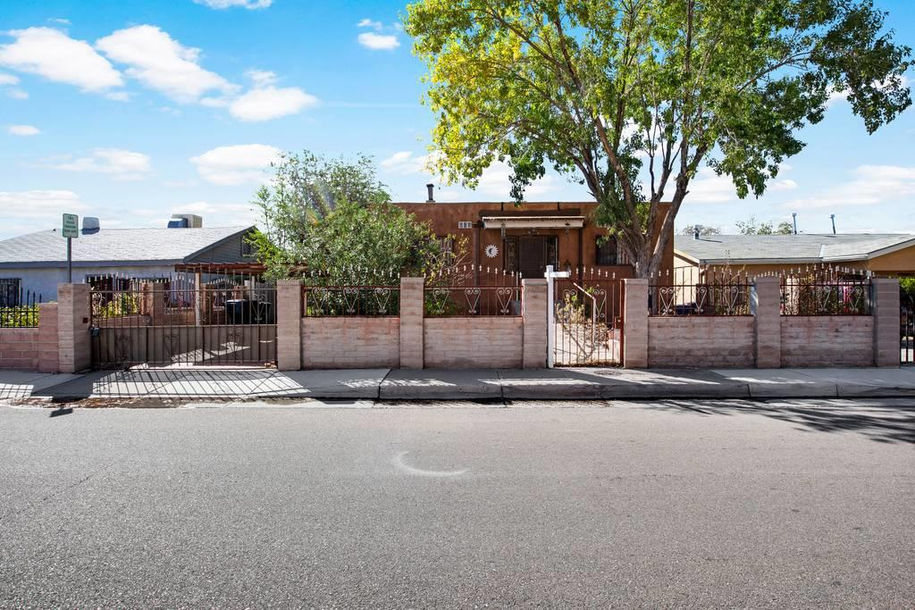 This cozy home has 1 bedroom with 2 full baths upstairs and a large basement downstairs with two additional rooms; each accessible from the interior or exterior of the home.  The property situated on a good-sized lot and located just minutes off I-25 & Avenida Ceasar Chavez and just a few miles from nearby Schools, Hospitals, KAFB, UNM & CNM.  The property is being Sold As-Is and is priced accordingly. No repairs will be made but definitely move-in ready!