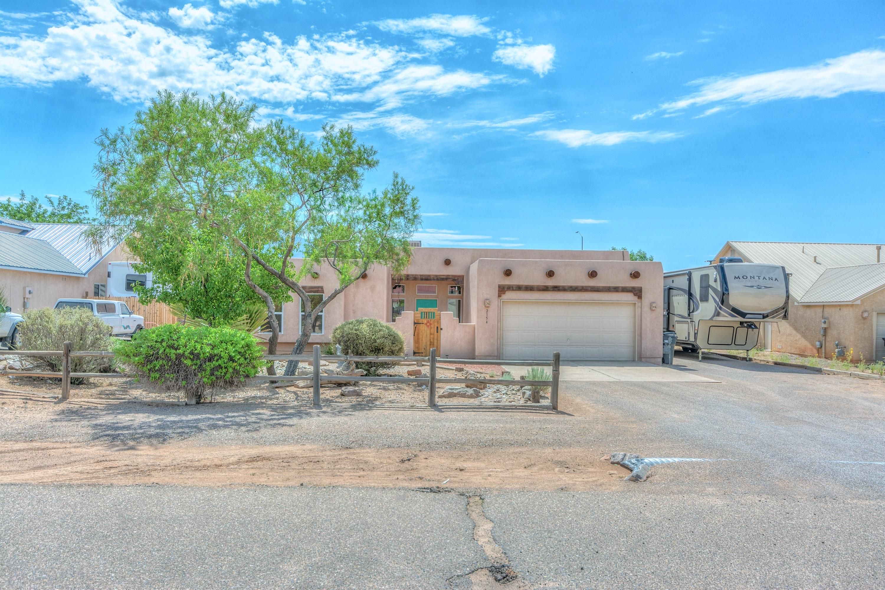 Pride of ownership! Gorgeous southwestern style home. Amazing views from your custom back patio! Back yard access. RV parking complete with clean out to the septic tank and electrical to get recharged! Garage is a tandem garage and has plenty of space to tinker or for storage! Easy access to Highway 528 for shopping and convenience.