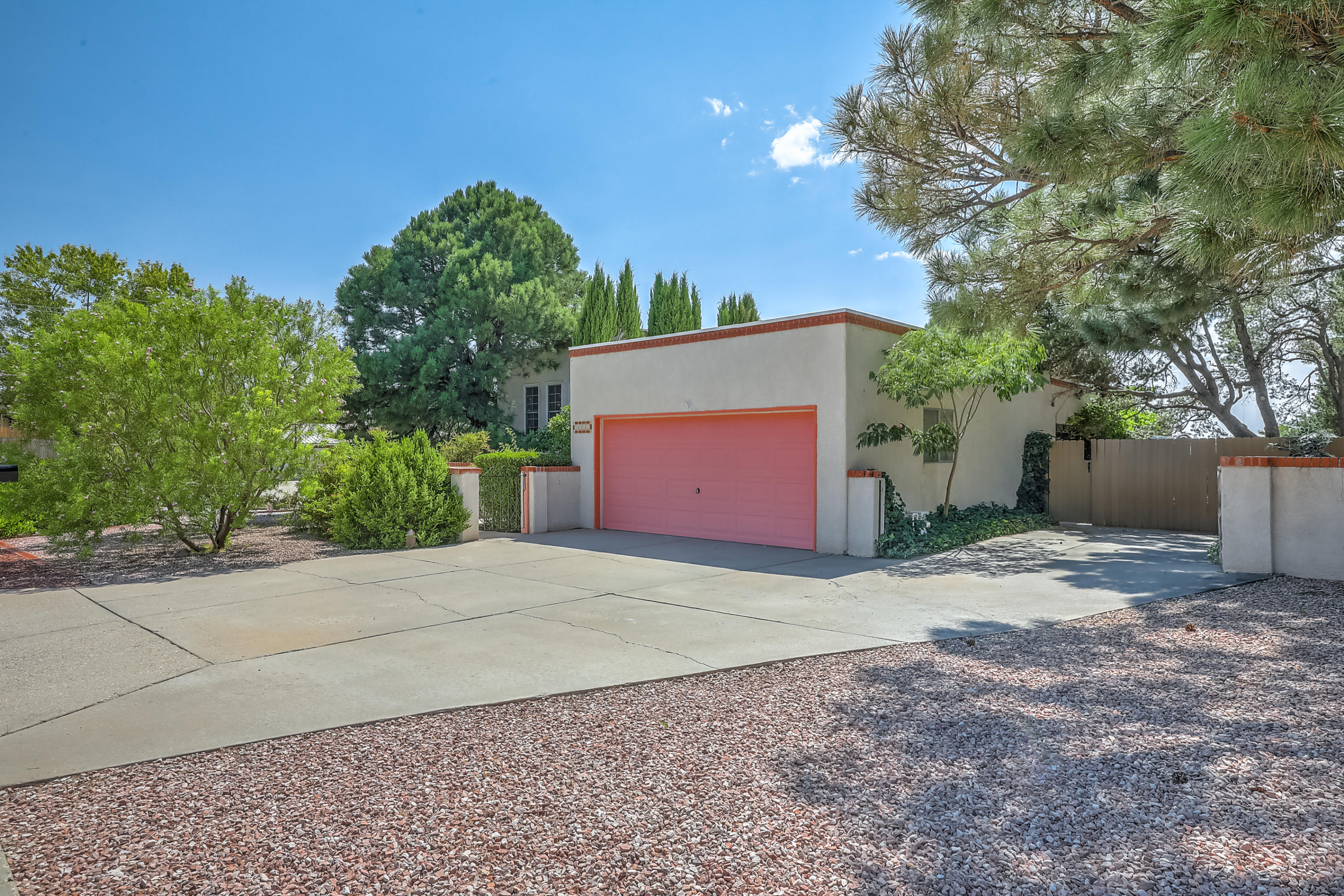 Don't miss out on this Desirable Foothills Location! This 4BDR 2Full Bath home is in a Great School District. Close to Tramway for easy access anywhere in town. Just minutes from walking hiking and biking trails. Extremely private, with a beautiful fully landscaped fenced backyard. Includes a large covered patio which is perfect for your families outdoor living. Separate back yard access to park your RV off and away from the driveway. This home boasts 2 large living areas. The spacious family room has built in bookshelves a built-in wet bar, a step down conversation area all situated around the fireplace. Separate dining room and large bright living room is great for entertaining.  Enjoy your light filled eat-in kitchen with views of the mountains which also, includes a desk hutch area.
