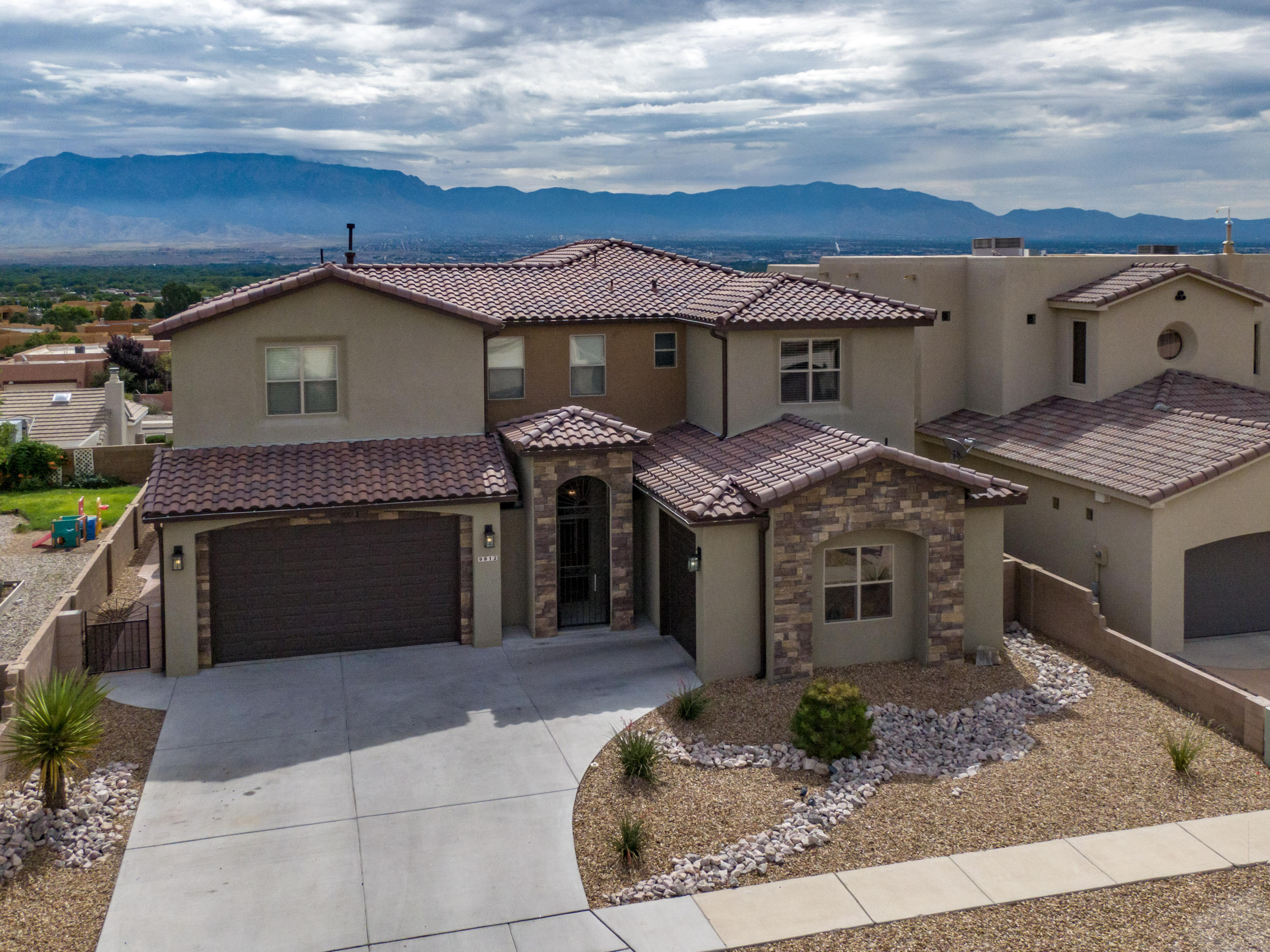 VIEWS, VIEWS, VIEWS!!!! Take a look at this stunning CUSTOM home on a desirable location with breathtaking views of the Sandia Mountains. This home offers a wonderful floor plan: two master bedrooms (one on each level), two large living spaces, a formal dining room, and a HUGE loft upstairs with an amazing balcony. The Chef's kitchen features a huge island, granite countertops, stainless steel appliances and walk-in pantry. Four full bathrooms, each with its own style but sharing the same high-quality tile and stone.  This home is located in the Knolls area, close to the schools, shopping centers, great restaurants and a movie theater. Schedule a showing today!  You don't want to miss the opportunity to own this amazing home!