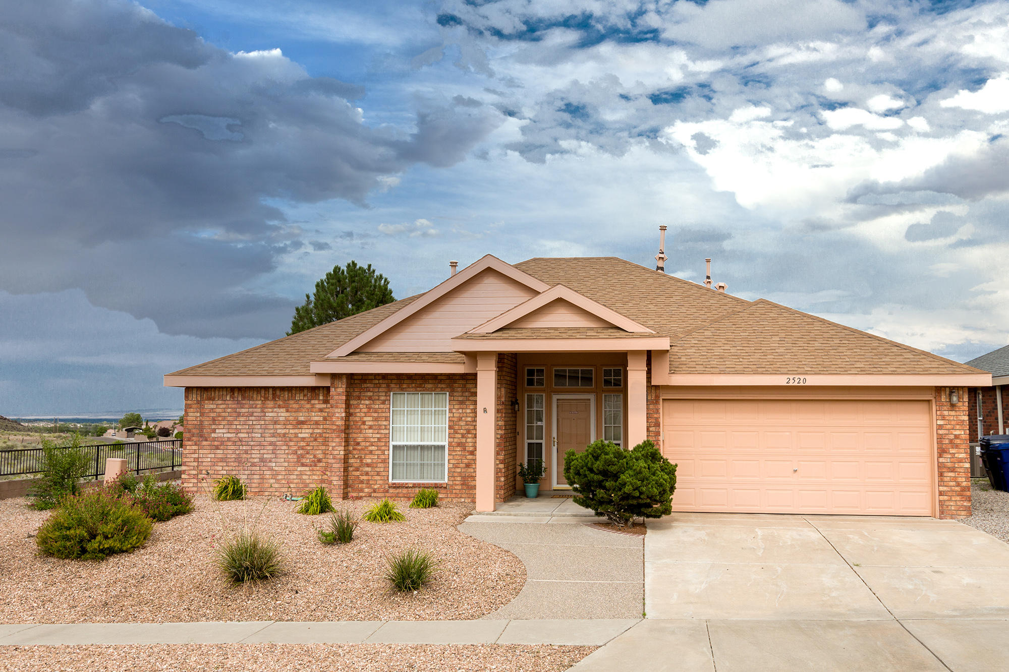 Beautiful brick home on spacious corner lot with views of petroglyphs.   Large covered entry.   Great room features high ceiling, fireplace with attractive tile surround, wall niche, & crown molding. Bright, open kitchen includes all appliances, island, tile countertops, track lighting, ceramic tile flooring  & breakfast nook with  door that opens to covered patio. Split floorplan provides privacy for primary suite, which boasts a sitting area, two walk-in closets, double vanity, garden tub, separate shower & private patio.  Enjoy comfort of  refrigerated air.  Garage w/space for workbench.  Storage shed w/built-in shelves. Washer/dryer included.   Lovely landscaping.  Half wall in 3rd bedroom can be framed in for privacy.  Convenient access to I-40.