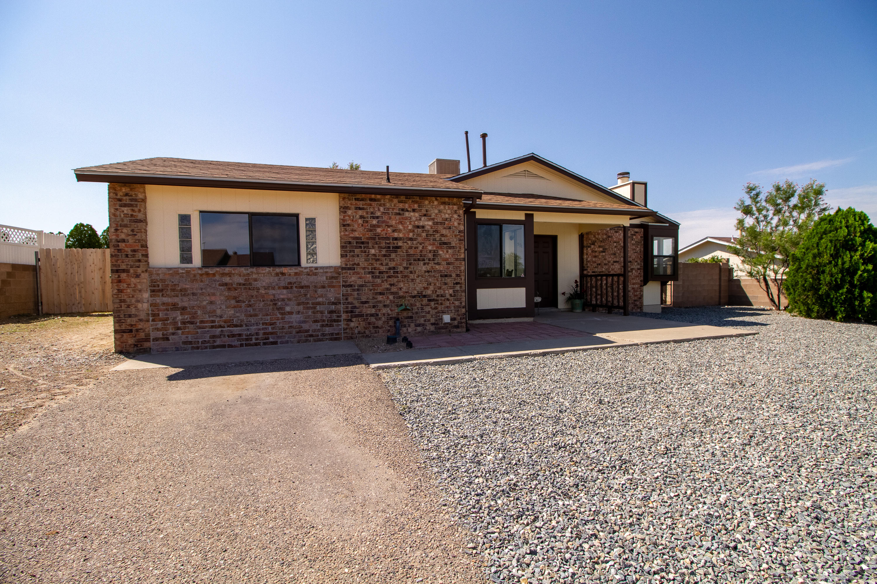 Come see this lovely home, is a five minute drive from Rio Rancho shopping. NEW plumbing, NEW roof, NEW paint inside and out, newer evaporative cooler and appliances. Washer, dryer, fridge, and stove are included. Home has backyard access with a LARGE back yard and a storage shed. This home won't last long!