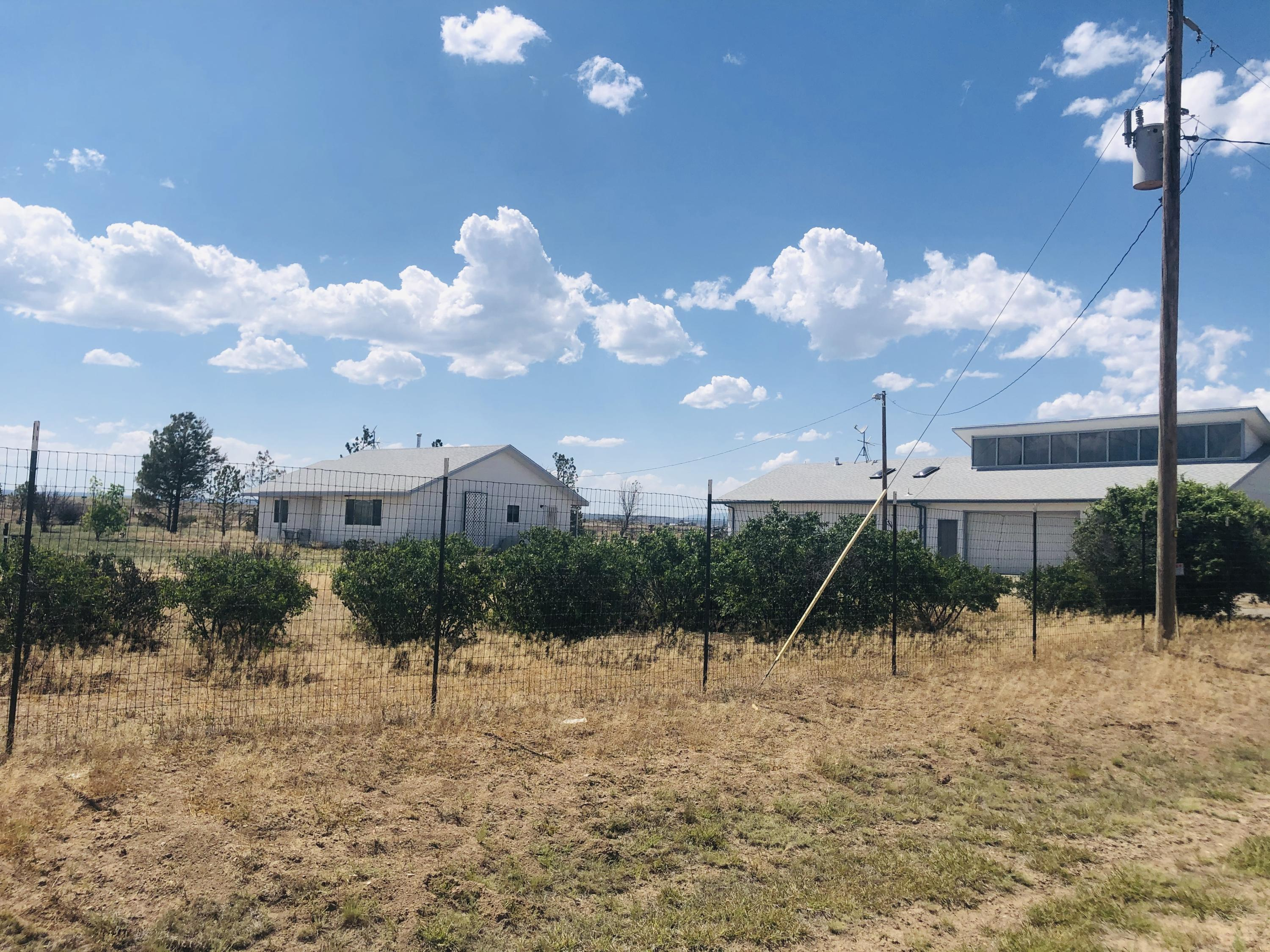 Amazing find in the heart of Estancia Valley.  Darling home with a detached 1 bedroom Casita with fireplace and full bathroom.   4 car garage attached to the casita with 400 sq ft huge metal shop on 10 acres. with an additional 10 acres available