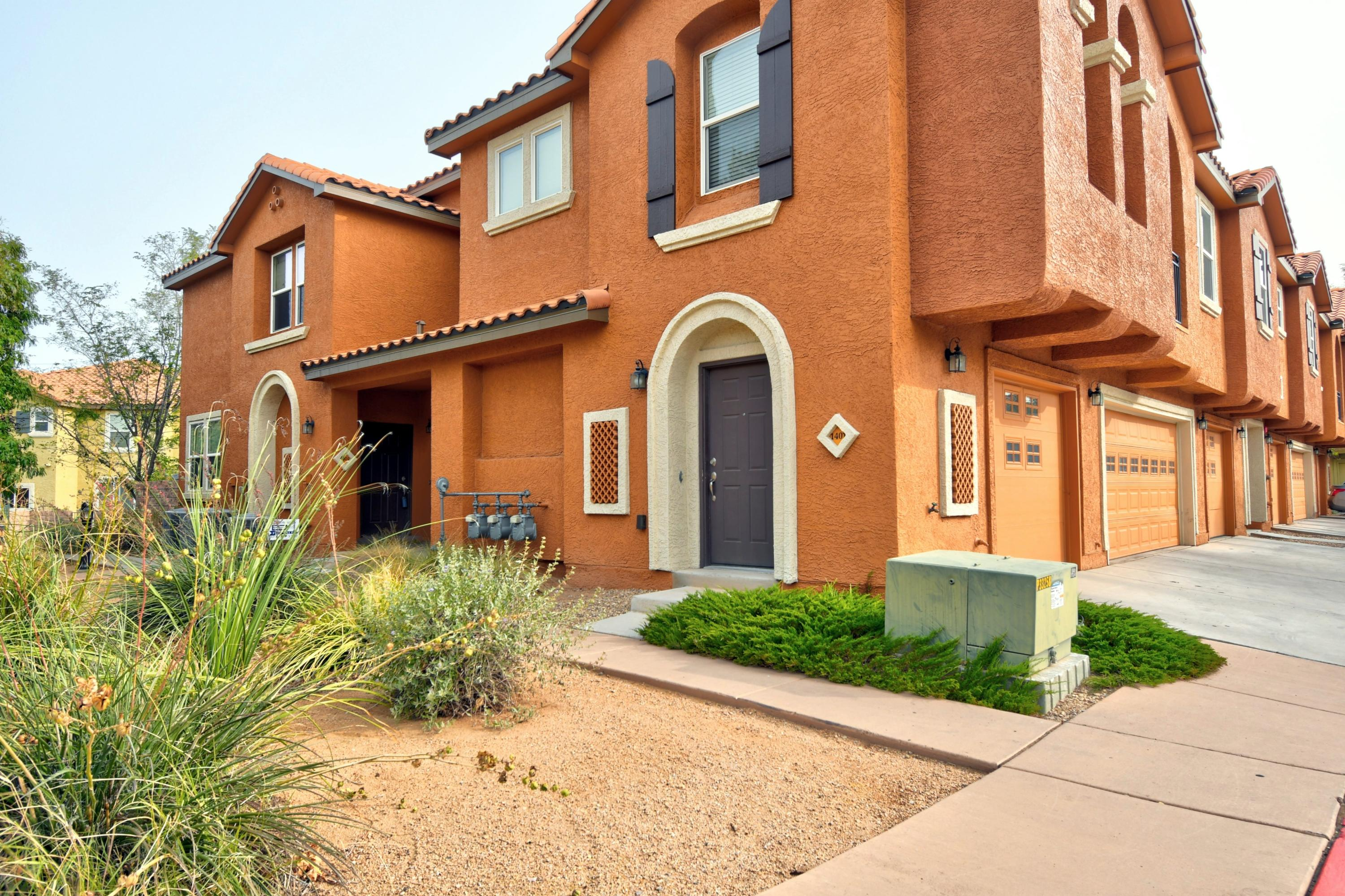 This townhome, located in the pristine Villas at Menaul, is surely one of the best in the community. Quick walking access to the pool, club house and community area and close additional parking make this unit very convenient and desirable. Two car heated garage.  Very large and inviting downstairs living and dining areas. Spacious master bedroom with garden tub and large walk-in closet. Large upstairs loft is perfect for second living area or optional third bedroom. Access to grass area from back patio and a doggy door perfectly equips this unit for owners with pets. Community pool and clubhouse seasonally available.