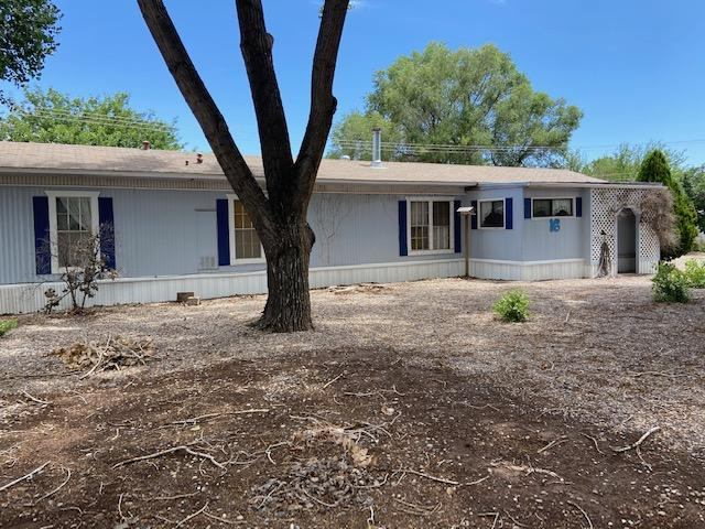 Great opportunity for an affordable home near shopping and schools in Los Lunas.  This is an older mobile home that will need some work.  Needs flooring in some areas and could use some TLC.  4 nice cottonwood trees in the .5 acre lot give nice shade and cover.  There is a 12 x 12 storage shed and a nice 21 x 24 shop/garage with a two carports.
