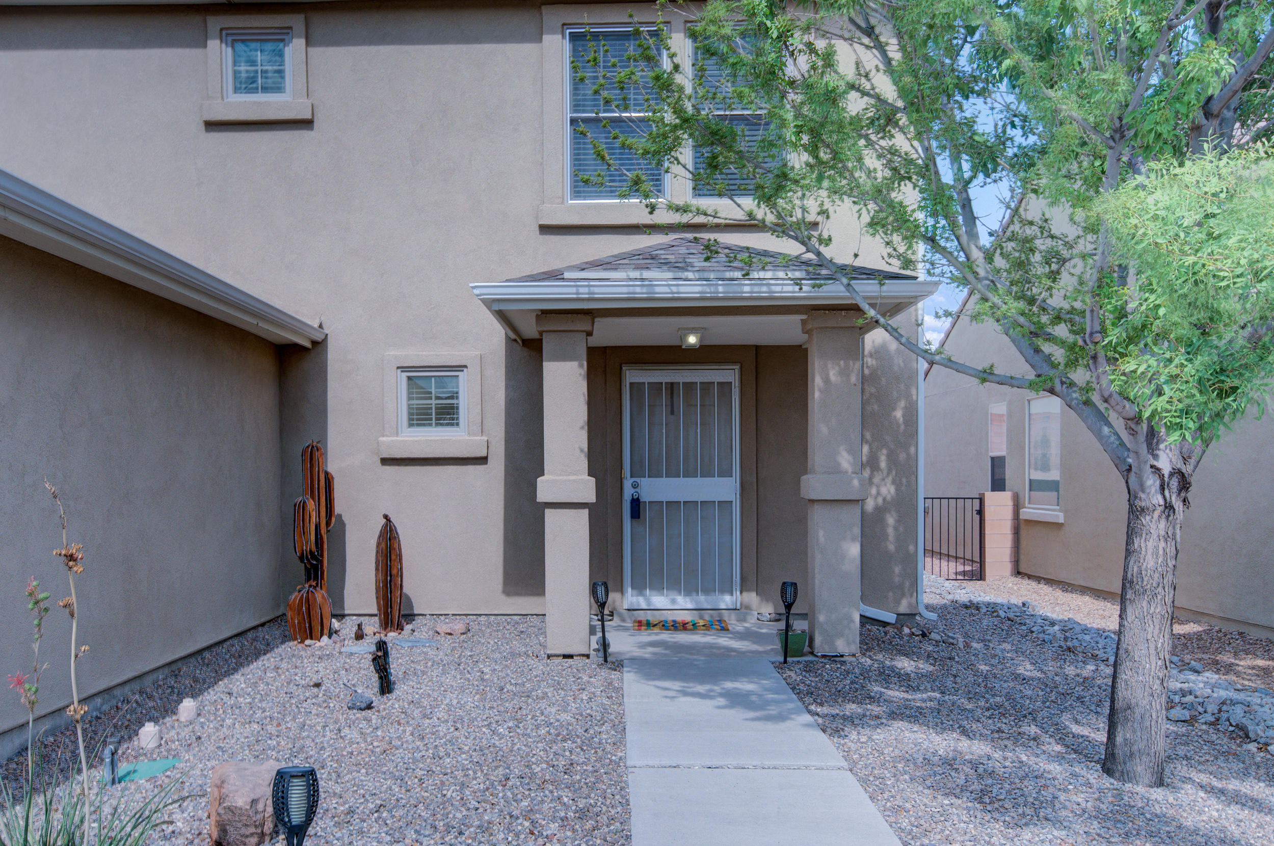 This beautiful Artistic home was a model home is in the desirable Cabezon community! Check out the size of the lot! The first floor features a large living room, dining room and kitchen with breakfast bar, new SS appliances which convey and  large pantry closet. There is tile in all wet areas and laminate in downstairs living areas. The master suite is large and its bath has double vanities, separate tub and shower. Master Suite has a large walk in closet. Home has 2x6 construction, R-21/R38 blown in insulation,and low e-windows for energy efficiency and refrigerated air.  The location is near shopping, restaurants, schools and Presbyterian Hospital. Enjoy the parks, walking trails and nearby city pool! Don't miss out on this one!
