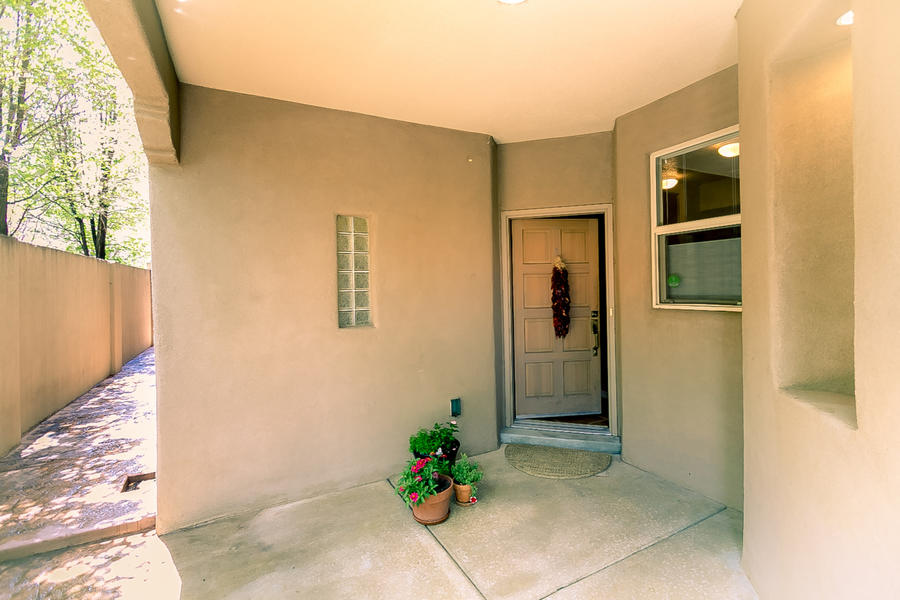 This well maintained home with many custom upgrades and magnificent views is located in the Desert Ridge gated community. This very open and spacious floor plan is great for indoor & outdoor entertaining. High beam ceiling, newer windows & gas log fireplace in living room. Gorgeous kitchen with beautiful countertops & stainless steel appliances & upgraded gas grill oven. Large laundry room with lots of built in storage. Master suite has private covered balcony, luxurious master bath & large walk in closet. The SW landscape allows for  easier maintenance, gated backyard access from front porch thru nice side yard path.  Half bath on the main floor. The upper level has 3 bedrooms w/ walk in closets & extra storage. Relax on the second floor spacious covered balcony w/ mountain views.
