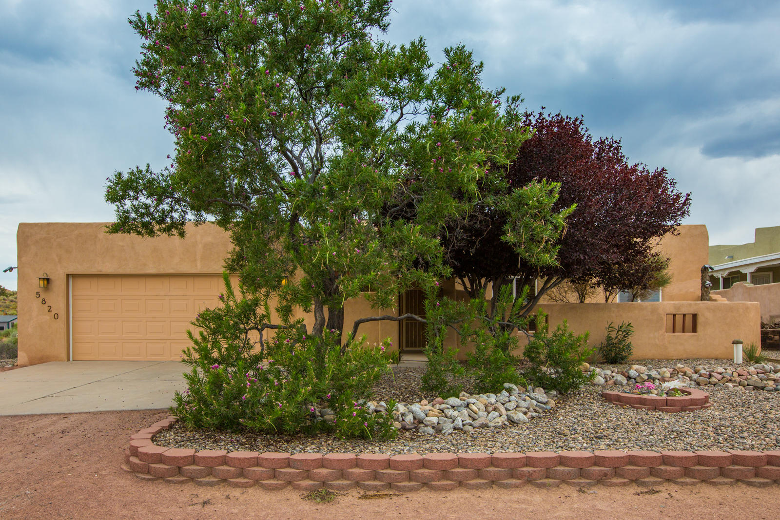 This amazing custom home is ready for it's next owner!  This well maintained home features three bedrooms including a large master suite.  The kitchen was just updated with granite counter tops and the entire home features tile and wood floors.  This pueblo style home has all the features you would expect including nichos, vigas and kiva style fire place.  This large half acre lot has a courtyard in the entry and a beautiful stucco wall and grass in the back.  A custom gate leads to the rest of the back yard with plenty of room for additional buildings or storage.