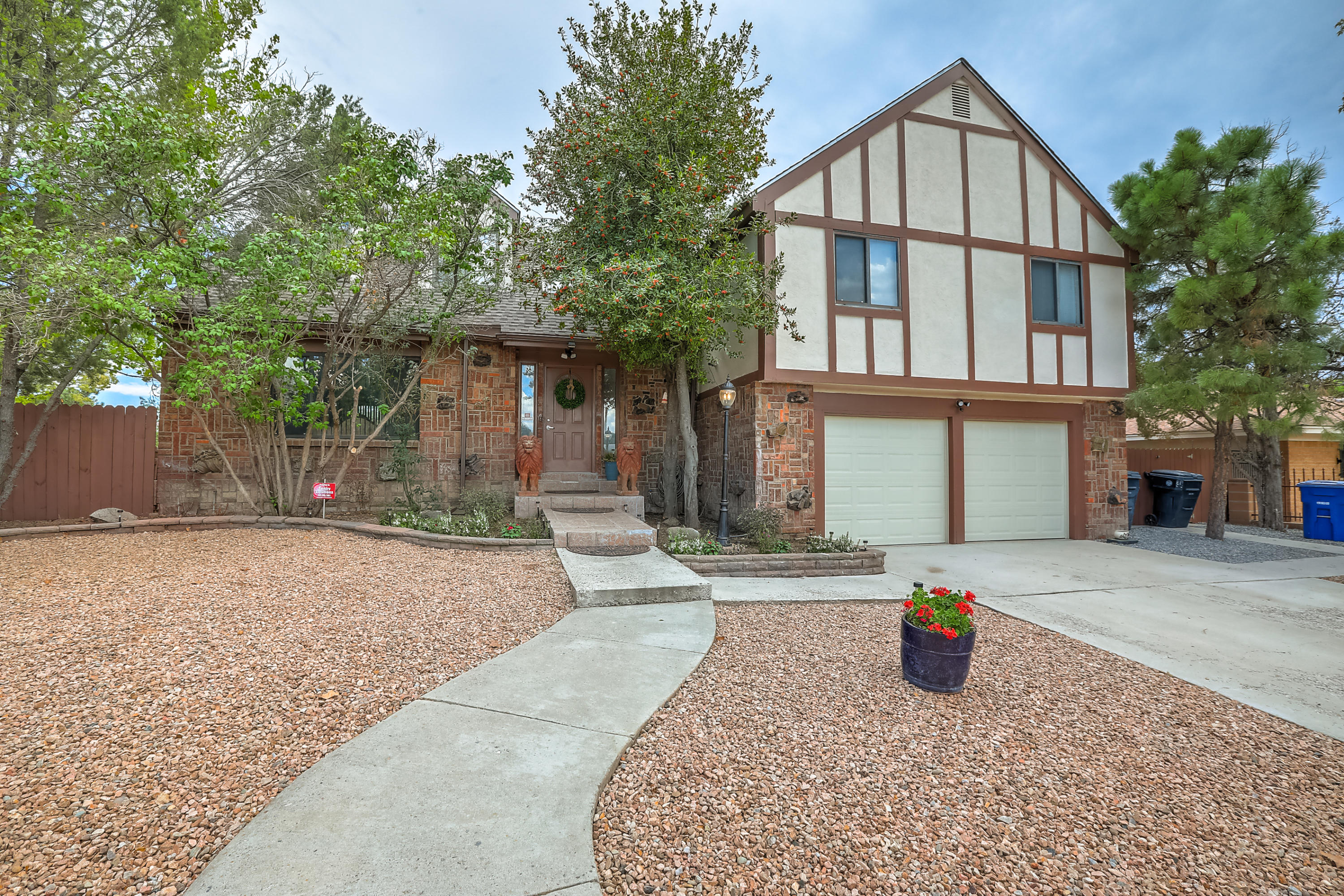 One of a kind spectacular NorthEast heights treasure awaits its new owners! Corner lot with new landscaping in front! Ample space for the growing family! Loads of storage in this home and Morgan shed out back! Remodeled kitchen with double ovens, microwave, dishwasher, solid surface counters, custom Hickory cabinets,designer back splash and good sized mobile island! Ceramic and porcelain tile floors except for carpeted bedrooms. Composite deck off the Master BR. Updated bathrooms! Cozy Family Room with wood burning Fireplace!Formal Living/ Dining space!Breakfast nook! REFRIGERATED AIR! Beautiful chandeliers! Hot tub stays with the home! Newer 6 panel interior doors throughout.Walk to popular schools and shopping! This home has been lovingly maintained! Come see this special property today!