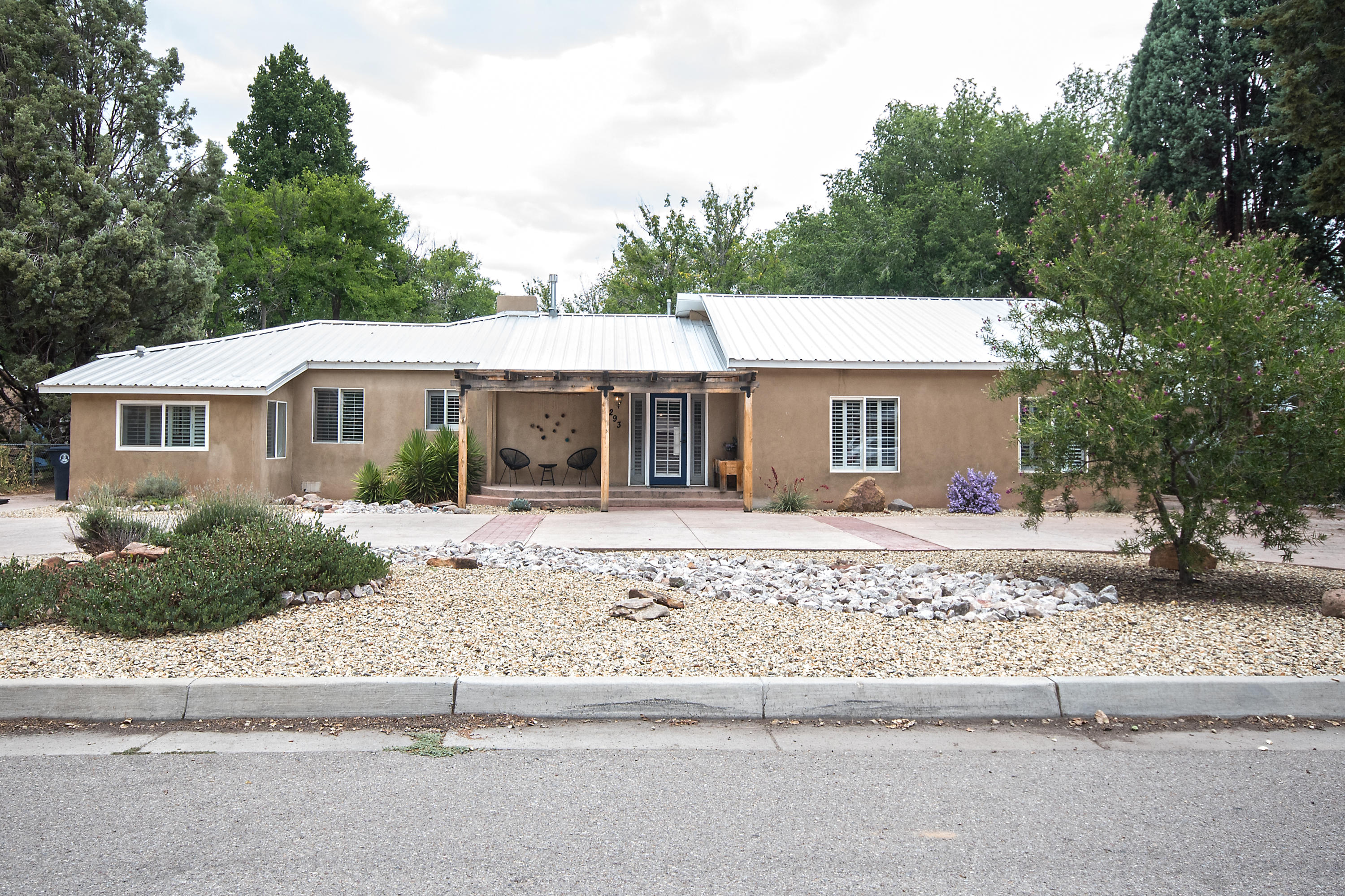 North Valley Treasure located in a quiet, well established neighborhood! Beautiful tree lined street. Natural lighting welcomes you into this 3/4 bedroom  /3 bath home! Chef's dream kitchen; quarts countertops and stainless steel appliances; enjoy the large island whether it be for a small family gathering, or for entertaining a larger audience... With the large island and custom feel, It will not disappoint!! Seller kept the beautiful original wood floors. Don't let this one slip through your hands. Truly Country living at it's best while enjoying the close proximity of shopping and restaurants.